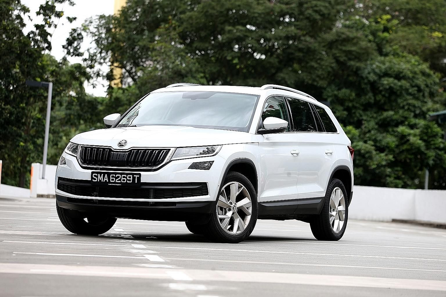 The Kodiaq drives more like a sporty hatchback than an SUV, with quick and sharp steering. Its start button is located on the steering column (left), where the ignition key usually goes, and its doors are equipped with door edge protection - a plasti