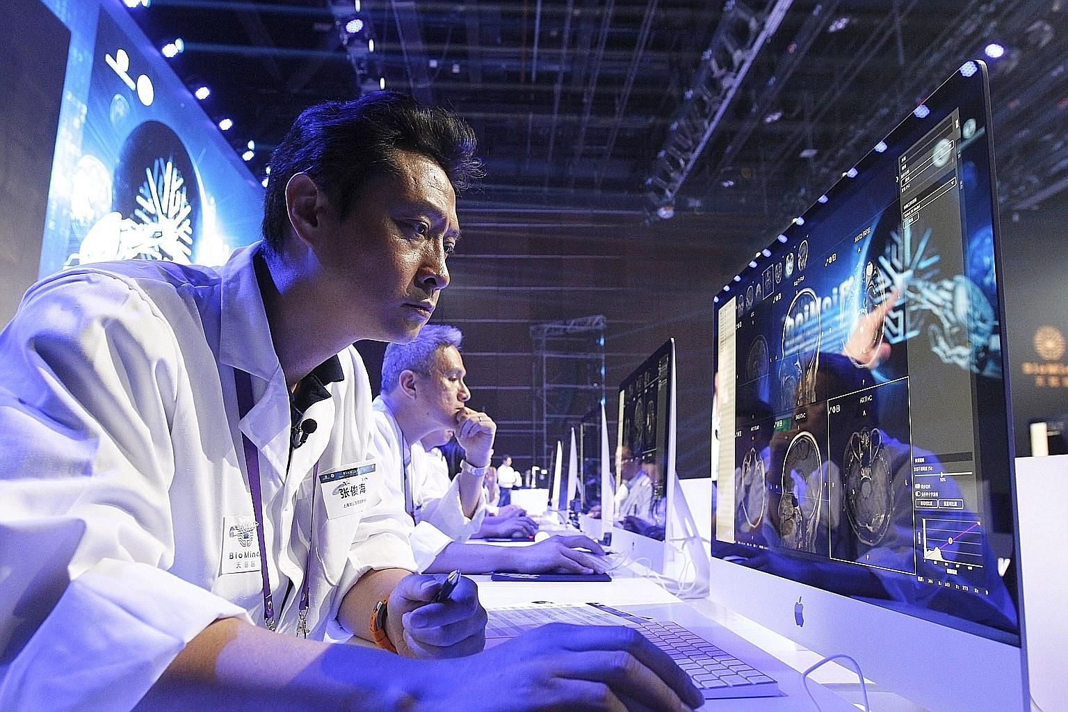 Doctors reading medical images on a screen during a diagnostic competition between an artificial intelligence machine and human experts at the China National Convention Centre in Beijing in June. China has picked up speed in innovation and is the onl