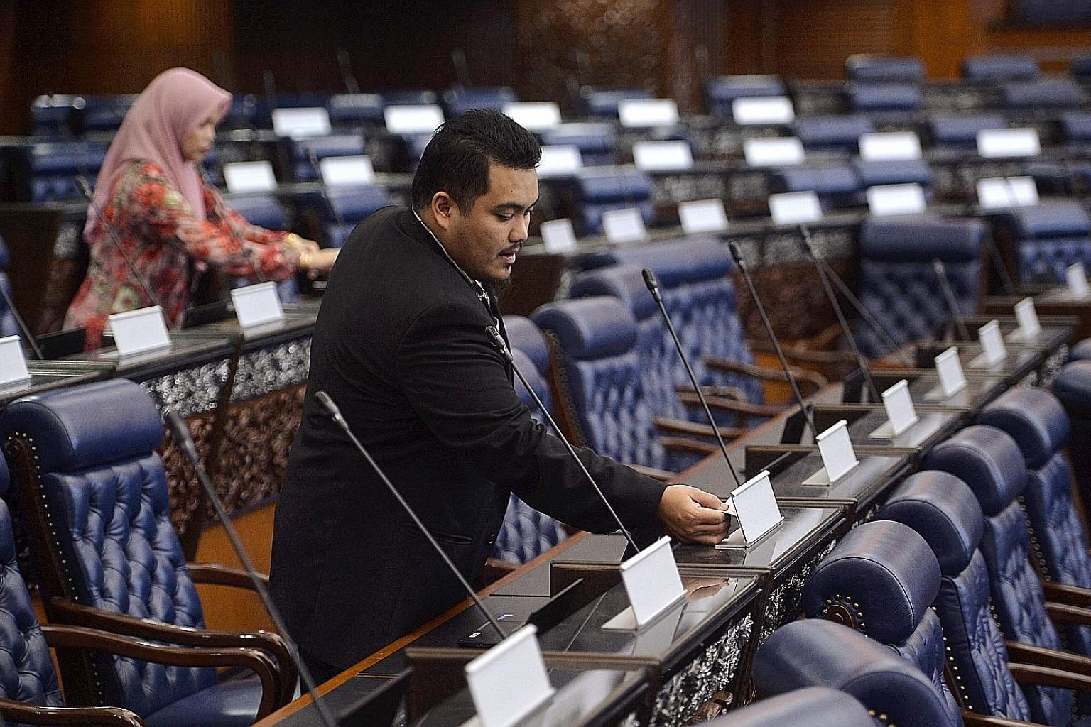 Staff preparing for Monday's Parliament session in Malaysia. Ninety of the 222 lawmakers who will take their oath are first-time MPs, the highest number since Parliament first convened in 1959. The 20-day sitting is expected to focus on rolling back
