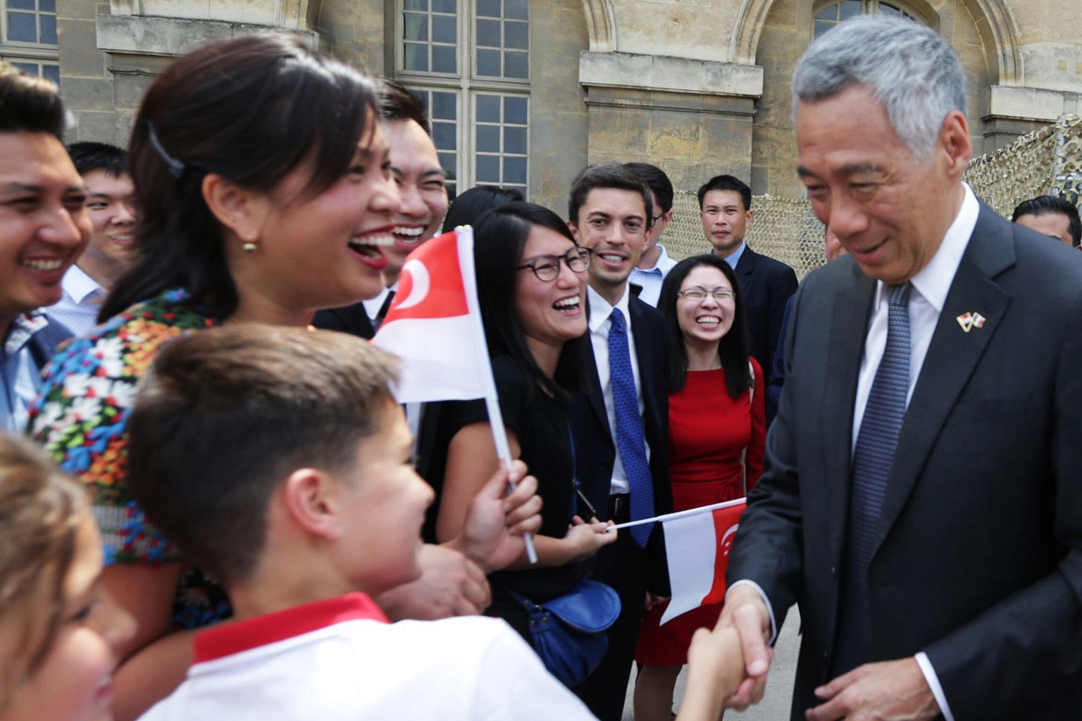 Singaporeans in Paris met Prime Minister Lee Hsien Loong at the Hotel national des Invalides yesterday. PM Lee is on a three-day official visit to France, and will attend the Bastille Day parade today as a guest-of-honour at the invitation of French