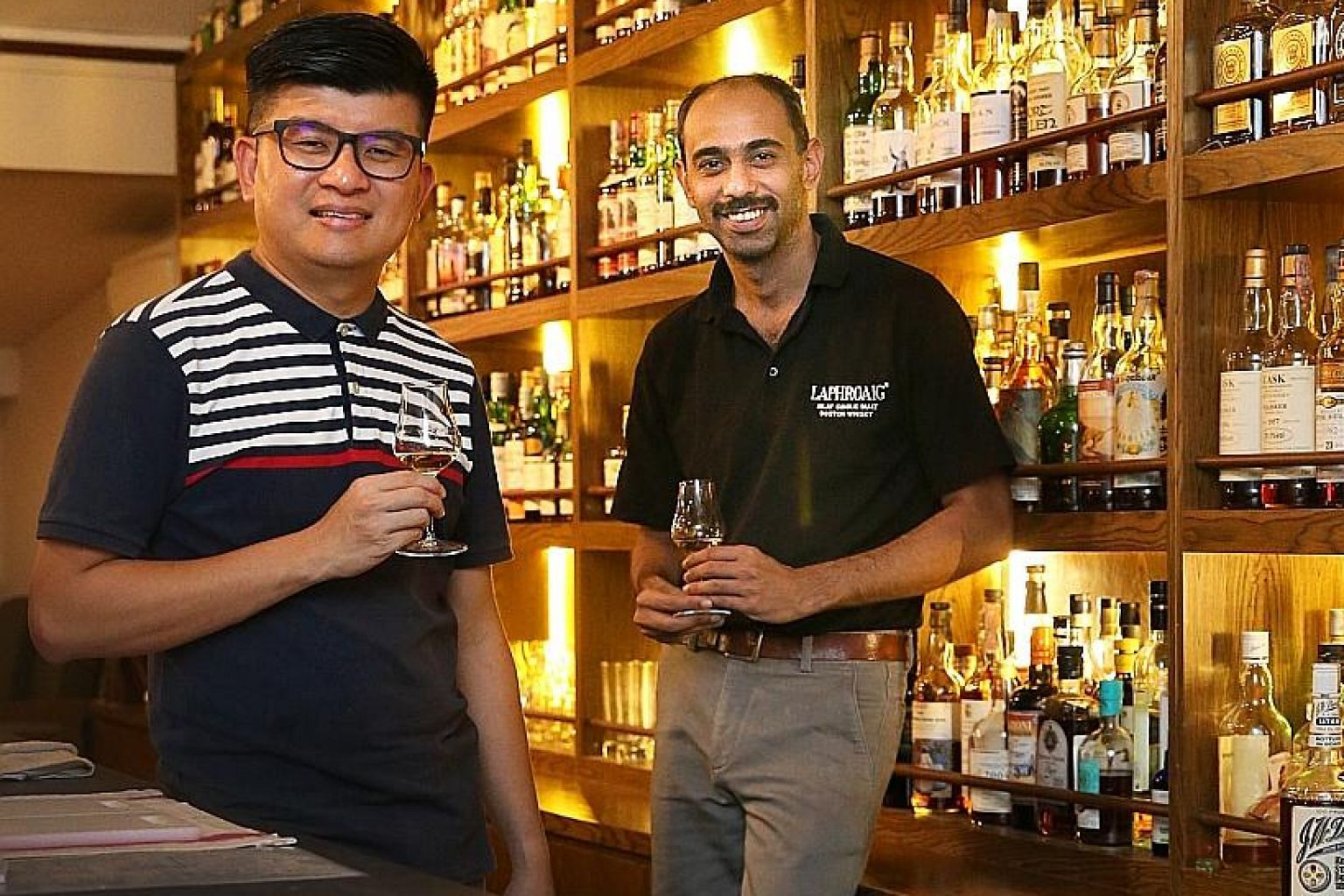 Co-owners Kelvin Hoon and Arun Prashant (both left) of The Swan Song have a treasure trove of rare and vintage whiskies.