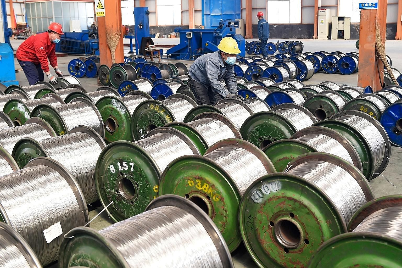Rolls of aluminium at a factory in Zouping in China's eastern Shandong province. Earlier this year, the US levied tariffs on steel and aluminium from China and elsewhere. With both countries appearing willing to re-enter into trade talks, attention w