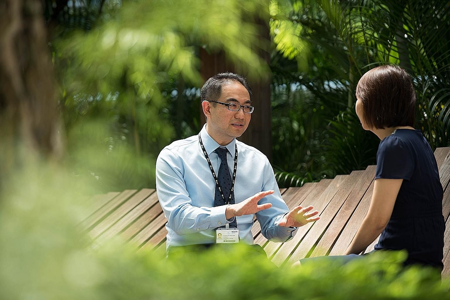 Dr David Tan, lead investigator of the Integrated Molecular Analysis of Cancer Programme, with Madam Tan. Being matched with a clinical trial has helped Madam Tan, who had undergone six operations to remove various organs as her ovarian cancer spread
