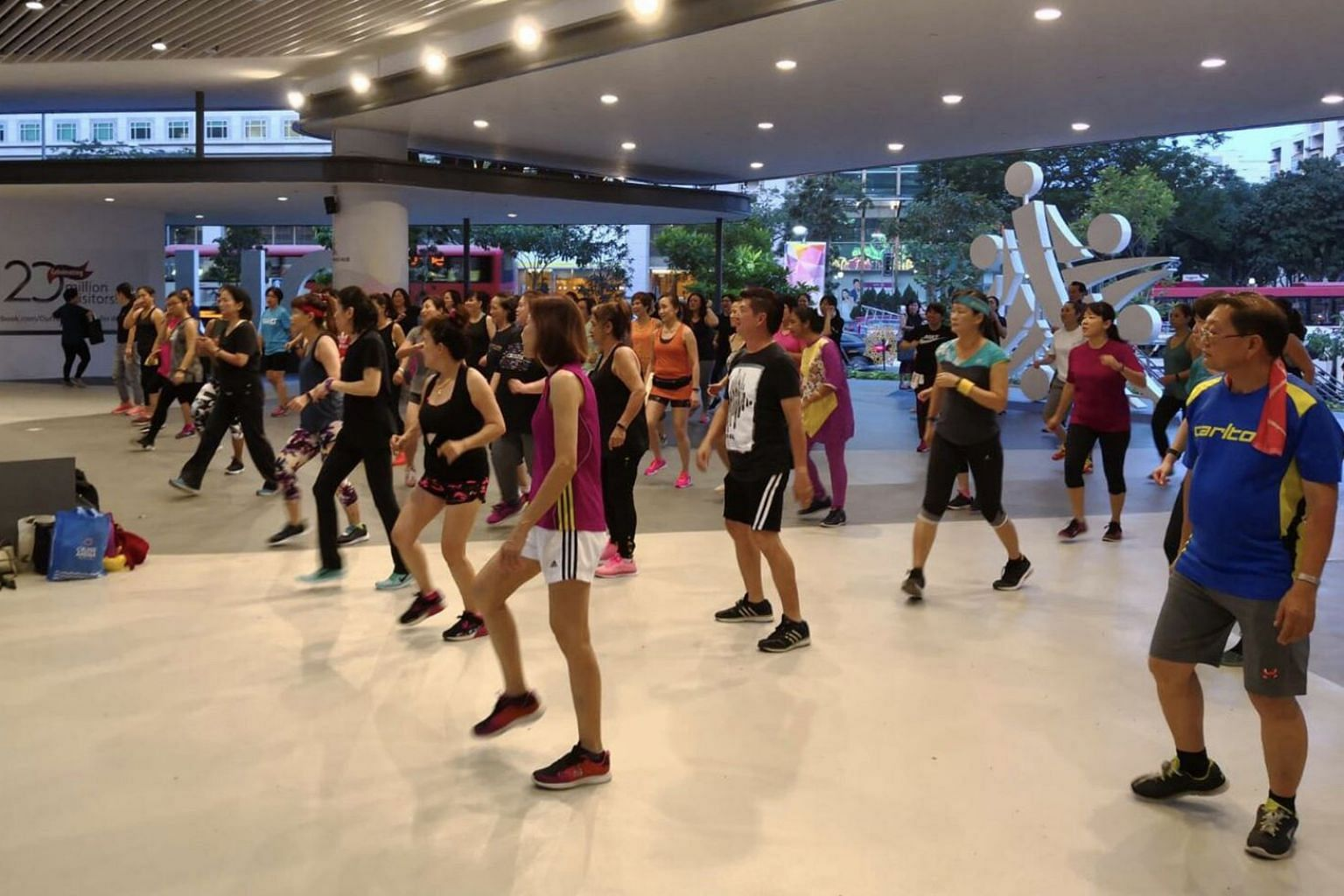 A Megadanz session being led by fitness instructor Heidi Lim at Gate 1 of Our Tampines Hub. This session, co-organised by People's Association, Our Tampines Hub and Alpha Fitness, takes place every Friday from 7pm to 8pm and is free.