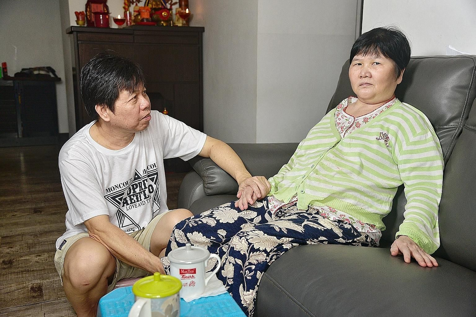 Madam Ang Liu Kiow at home yesterday with her husband, Mr Leong Loon Wah, who says her condition has improved since the 2016 crash, which left her in a month-long coma.