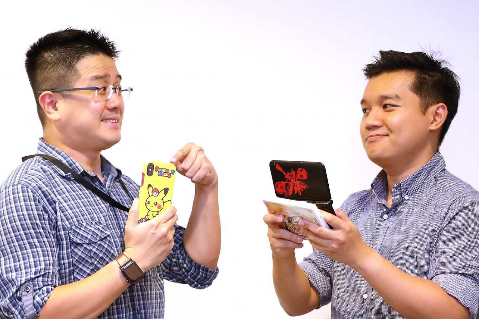 To play or not to play? Tech writers Trevor Tan (far left) and Lester Hio feel differently about Pokemon Go.