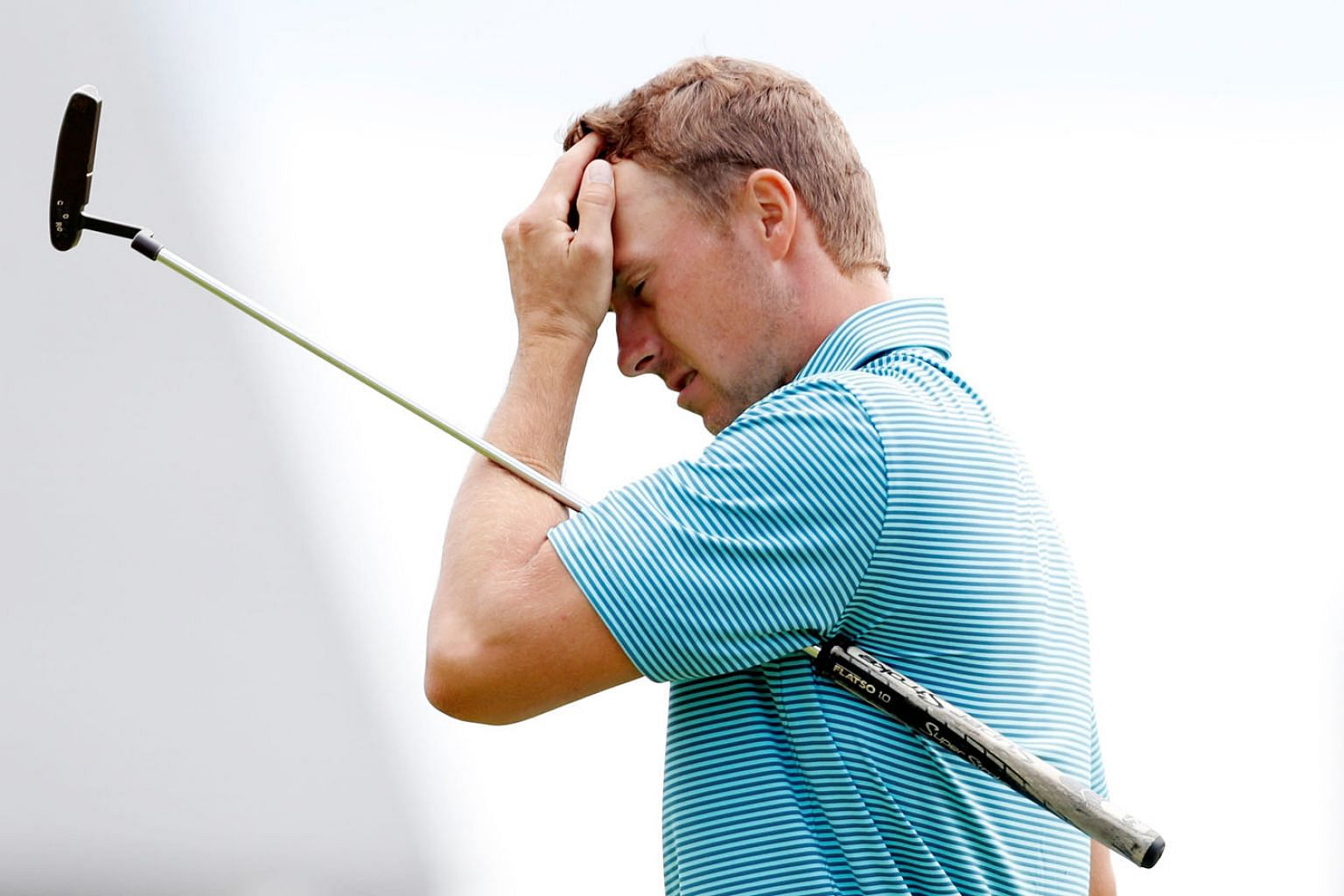 Defending champion Jordan Spieth shows his frustration at the end of his first round at The Open Championship in Carnoustie, Scotland.