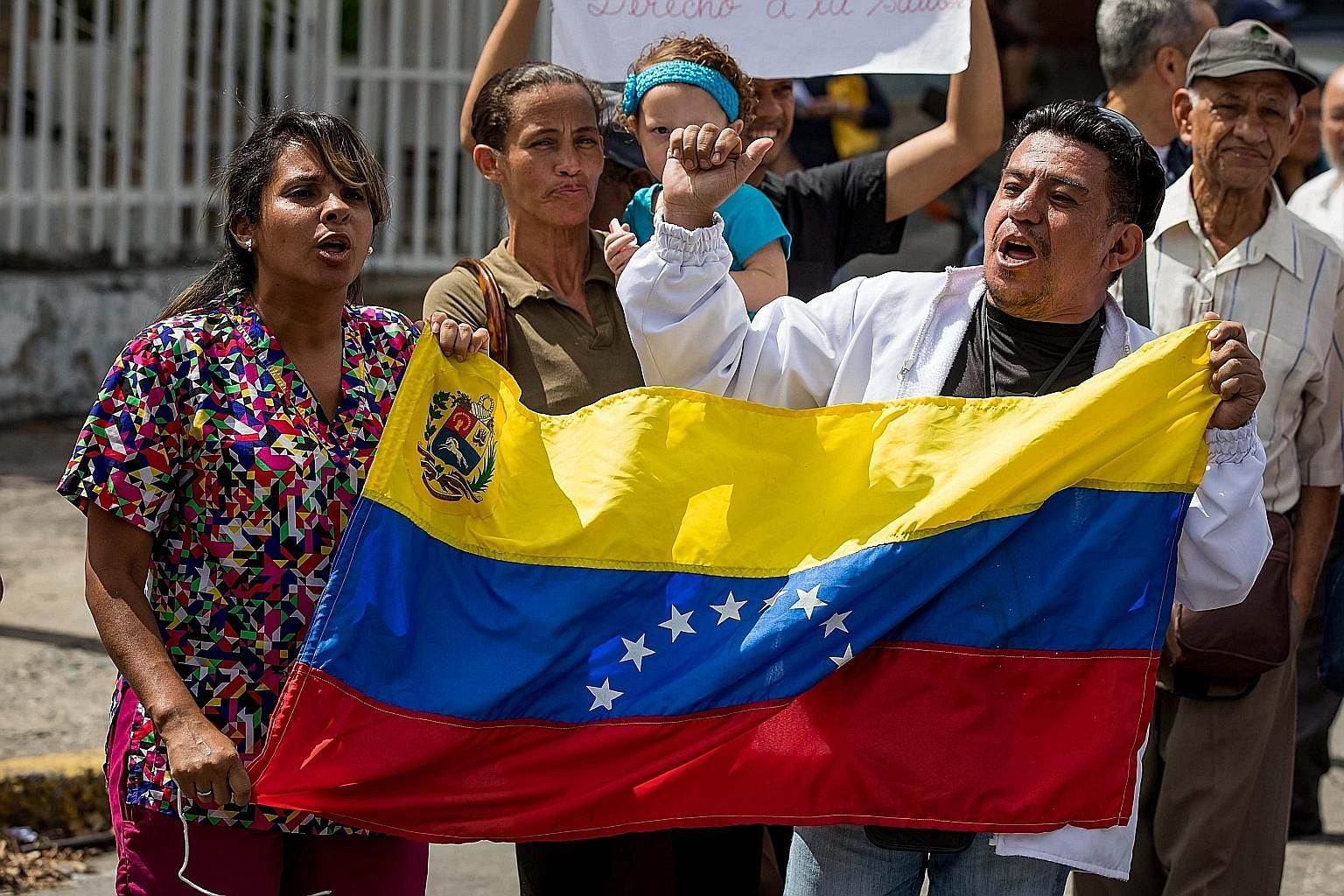 Venezuelan hospital workers protesting in Caracas on Wednesday. An economy deeply dependent on faltering oil exports, distorted by ill-conceived policy gimmicks over many years, has produced shortages of the most basic consumer products, including fo
