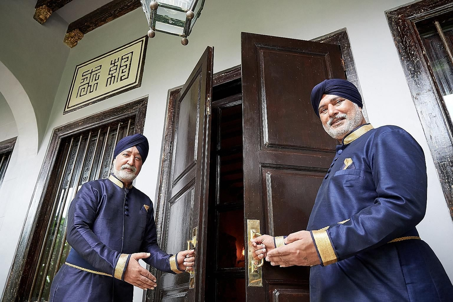 Brothers Swaran Singh (left) and Sarjit Singh were doormen at Raffles Hotel for 26 years.