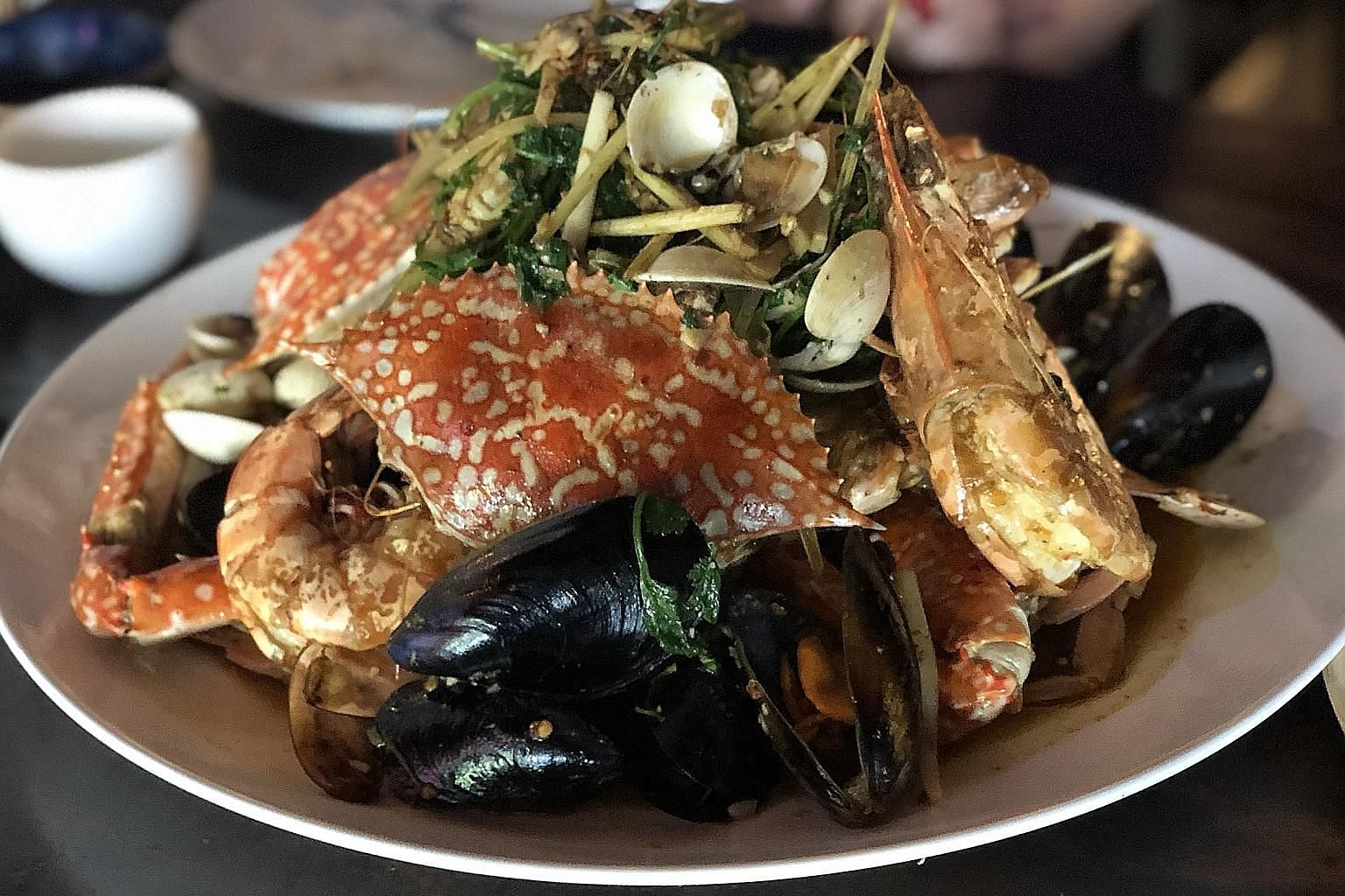(From above, clockwise) Spaghetti With Basil, Dried Shrimp & Grilled Prawns; St Kilda Shellfish Stirfry and Full Circle Port Arlington Mussels are among the highlights at Claypots Full Circle.