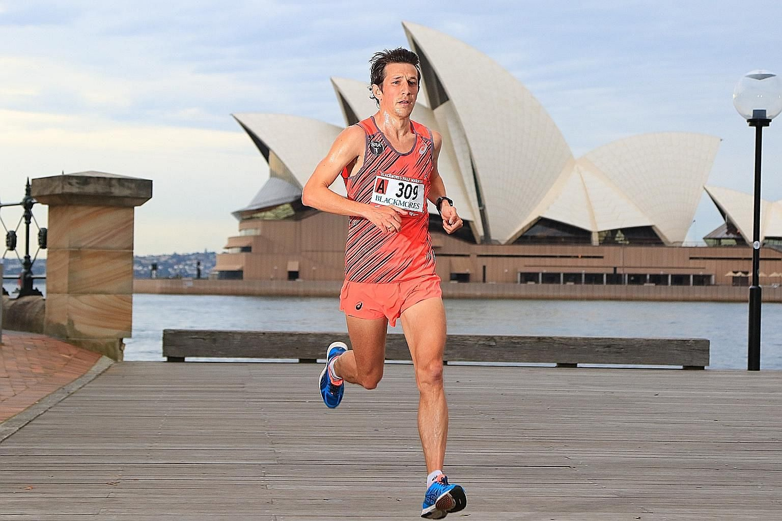 Ben Moreau running the Sydney Blackmores Marathon when he was based in Australia. He has run in more than 20 countries.