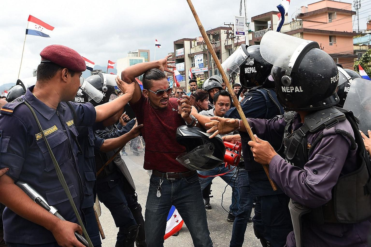 Activists of the Nepal Tarun Dal, the youth wing of the opposition Nepali Congress Party, scuffling with police at an anti-government protest in Kathmandu last Saturday. Dozens were hurt as they supported Dr K. C. Govinda, who has been on a hunger st