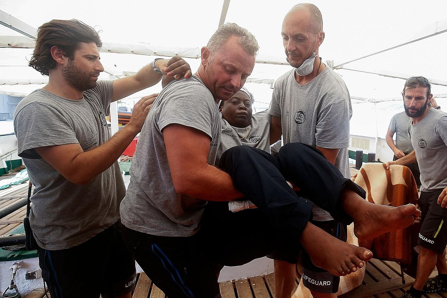 Ms Josepha, found drifting on a deflated dinghy, being carried off the Proactiva Open Arms boat in Palma, Spain, last Saturday.