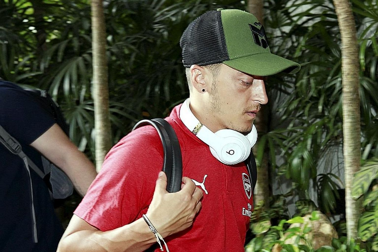 Arsenal midfielder Mesut Ozil arriving in Singapore yesterday for this week's International Champions Cup. The German announced his retirement from international duty on Sunday, accusing German FA president Reinhard Grindel of racism.