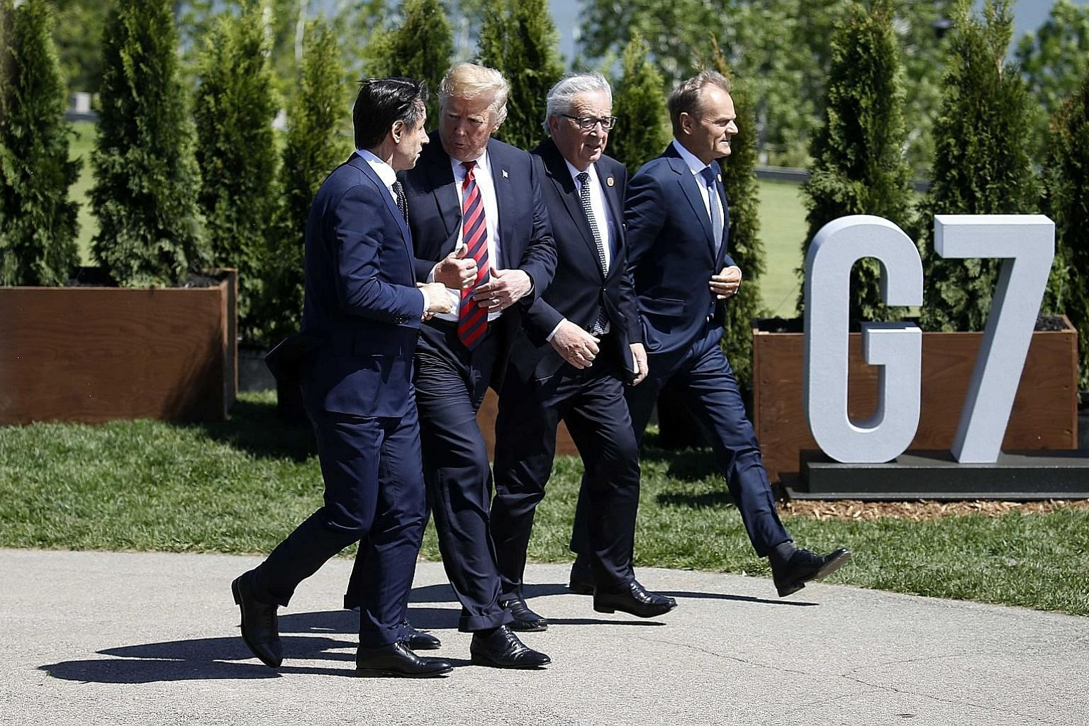 From far left: Italy's Prime Minister Giuseppe Conte, US President Donald Trump, European Commission president Jean-Claude Juncker and European Council head Donald Tusk at the Group of Seven summit in Canada last month.