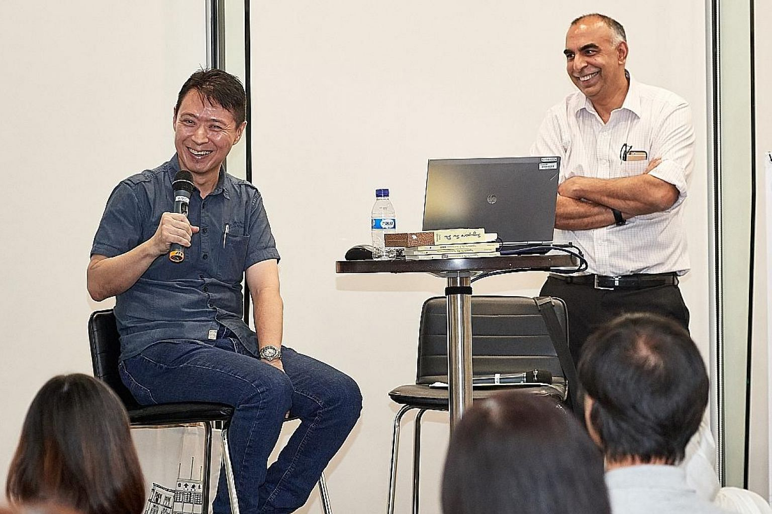 Local author Felix Cheong (left) with ST assistant sports editor Rohit Brijnath at The Straits Times Book Club yesterday. Cheong's latest work is a children's picture book titled Use Your Head.