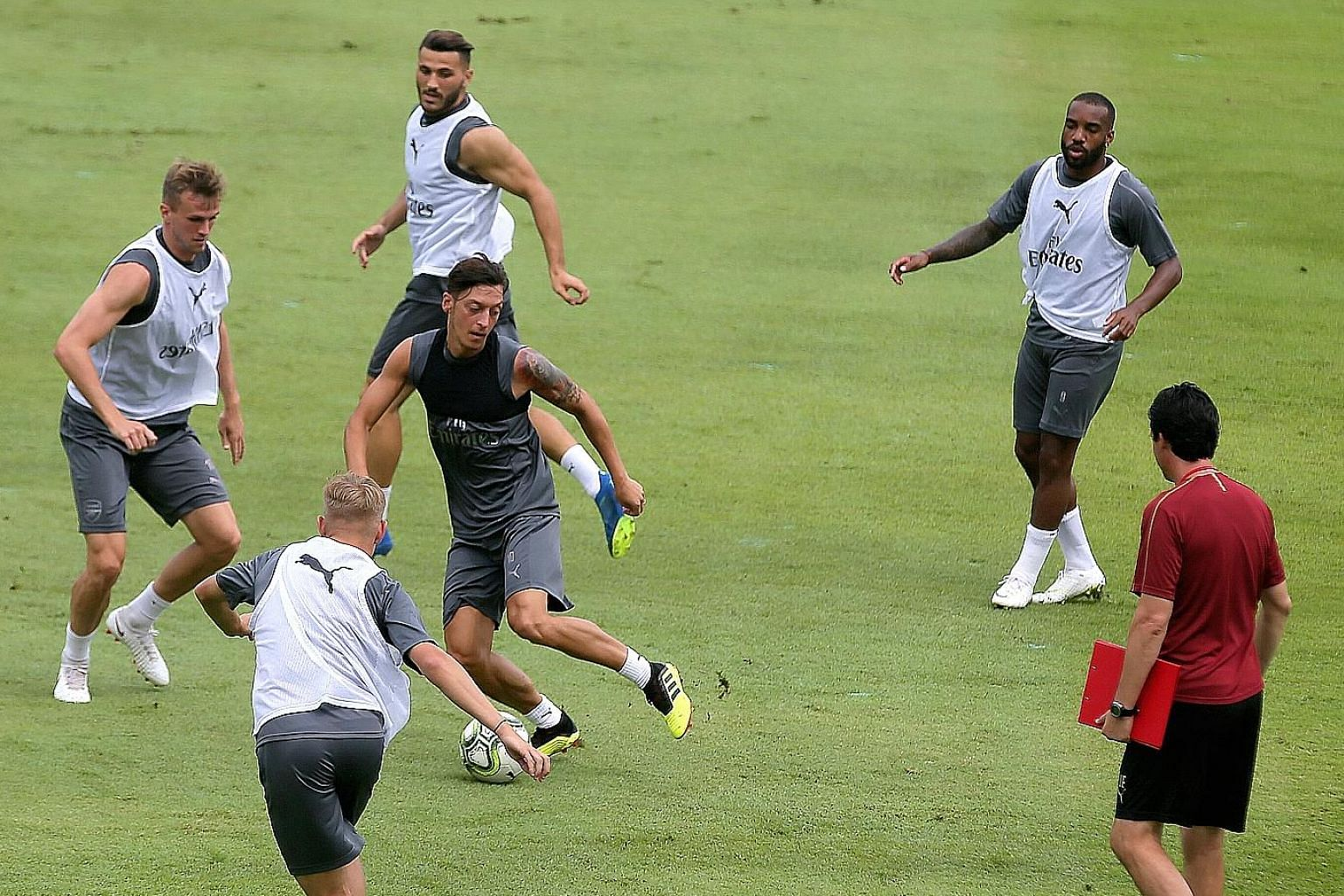 Wherever he goes, Mesut Ozil, on the ball, is usually the centre of attention. He and the Arsenal team trained yesterday at the Singapore American School ahead of their International Champions Cup match tonight against Atletico Madrid at the National
