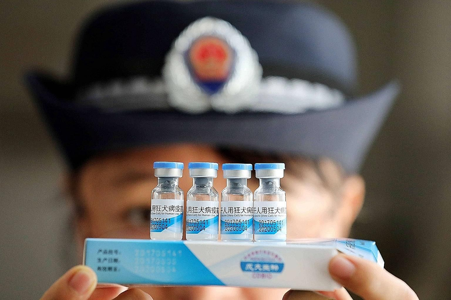 A law enforcement officer from the market supervision and administration bureau checking vaccines in Rongan, China.