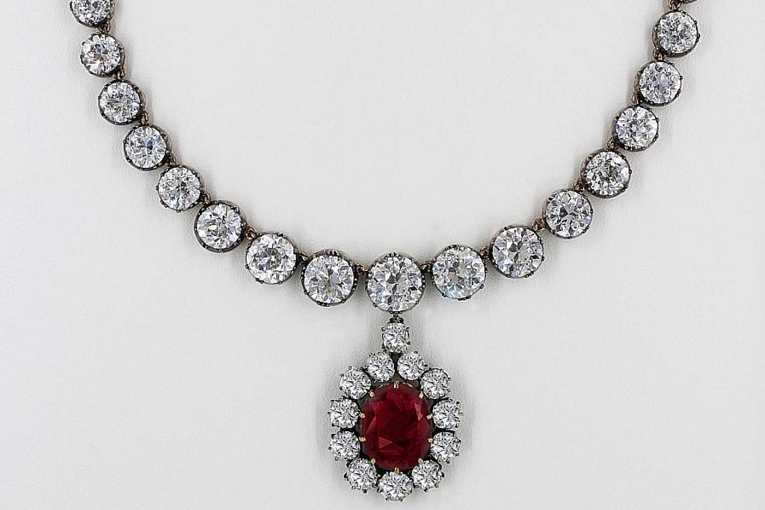 The star of the show is a pigeon blood oval ruby and diamond necklace by Malaysian jeweller DeGem. The ruby, weighing over 15 carats, commands a value of not less than $13.6 million.