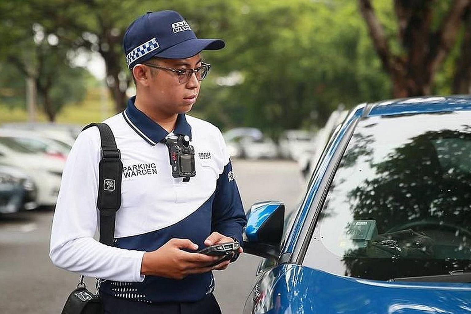 Parking wardens will don a new uniform comprising a dri-fit top and cargo pants from Aug 1, to help them cope better with the hot, humid weather.