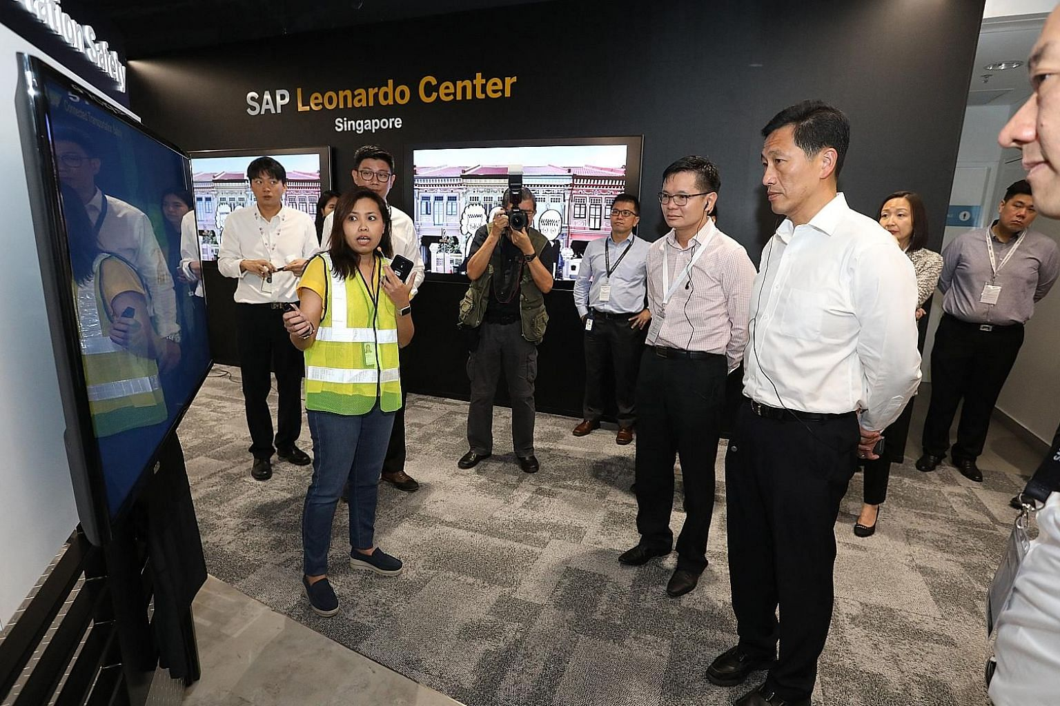 Minister for Education Ong Ye Kung (right) and SkillsFuture Singapore chief executive Ng Cher Pong on a tour of the SAP Leonardo Center Singapore, which showcases emerging and new technologies.