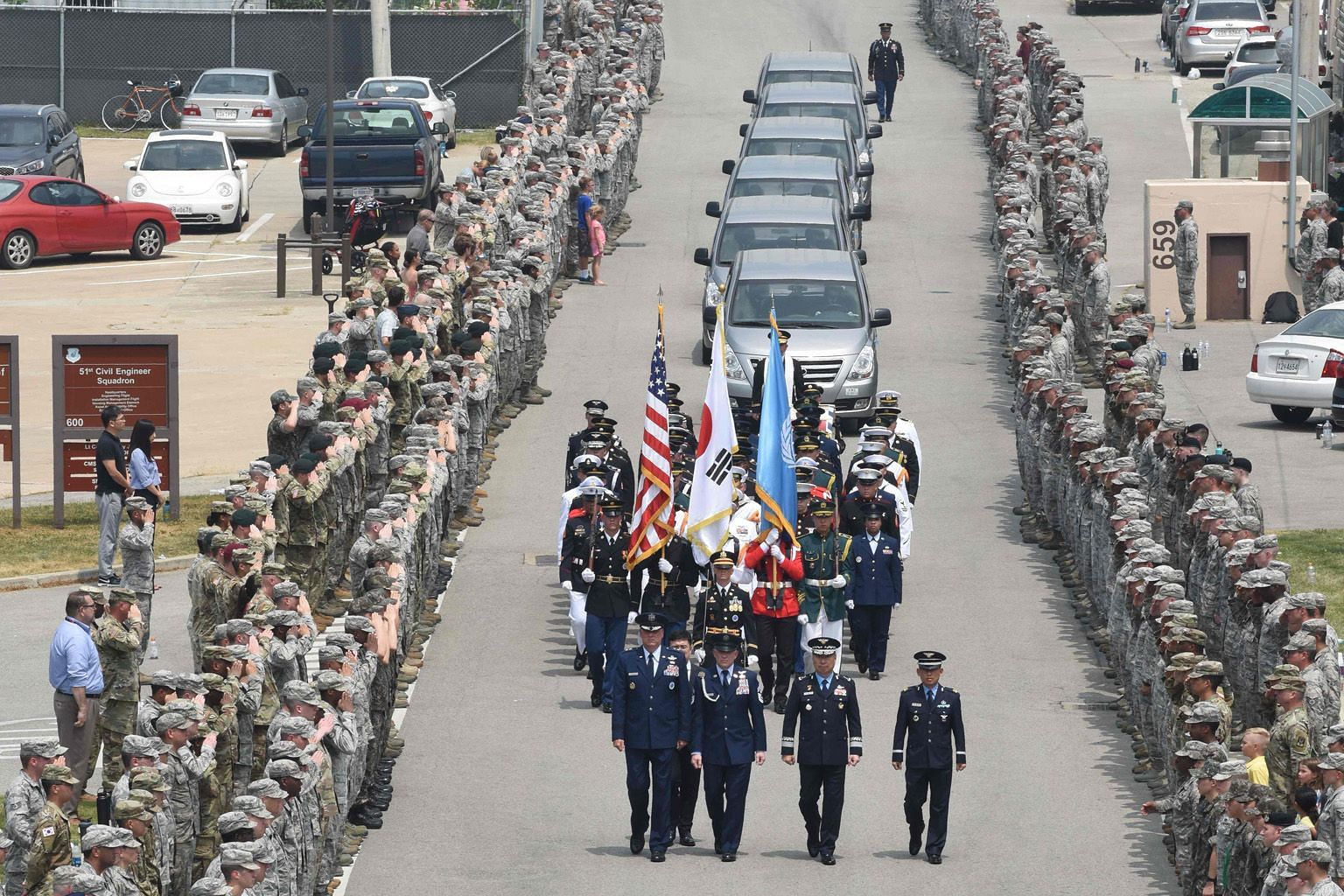 A United Nations Honour Guard member carrying the remains of a US soldier at Osan Airbase yesterday. The return of the soldiers' remains marks the first tangible step in implementing a landmark agreement reached between the US and North Korea at the