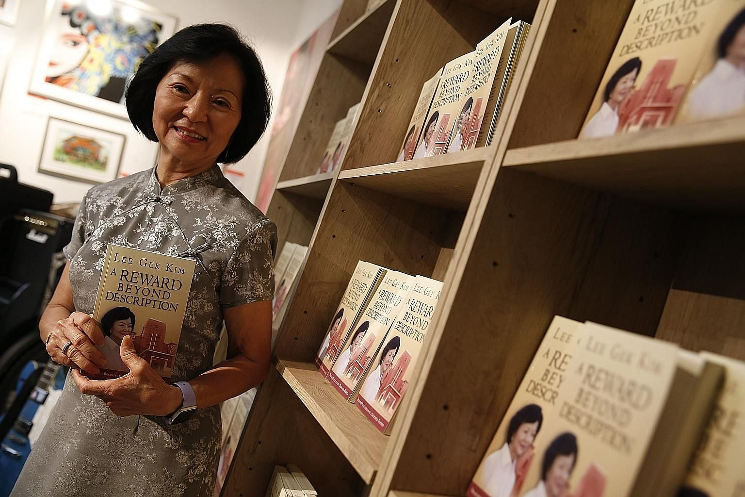 Mrs Lee Gek Kim with her book, A Reward Beyond Description, which describes her 50 years as a teacher. One of the highlights of her career was seeing all 43 Anglo-Chinese School students of 1988's Secondary 4A class score an A1 for English literature