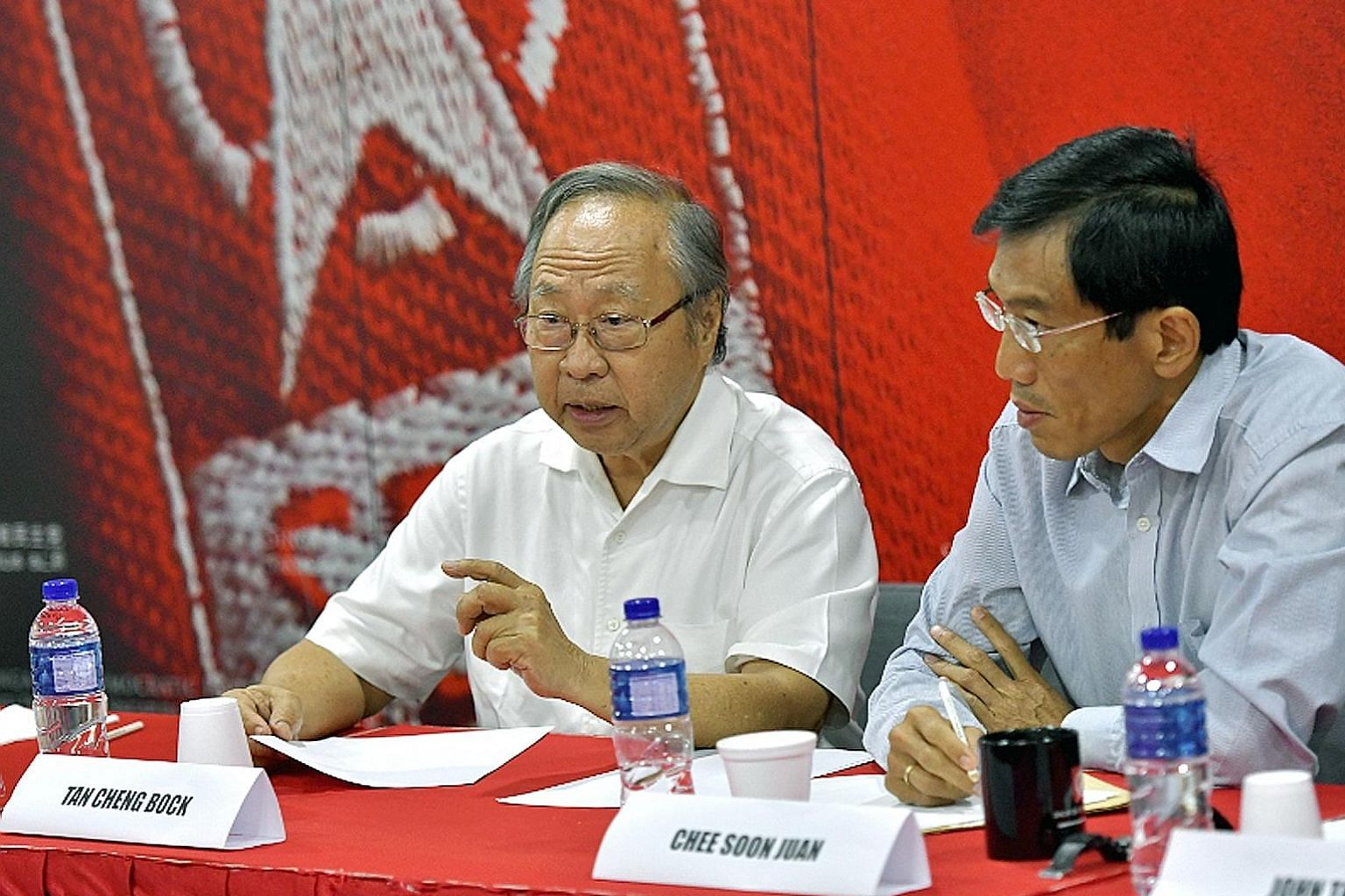 Former PAP MP Tan Cheng Bock (left) and SDP chief Chee Soon Juan at Saturday's meeting. Efforts to form an alliance had been ongoing without success, but the Malaysian election result was a turning point, said opposition leaders.