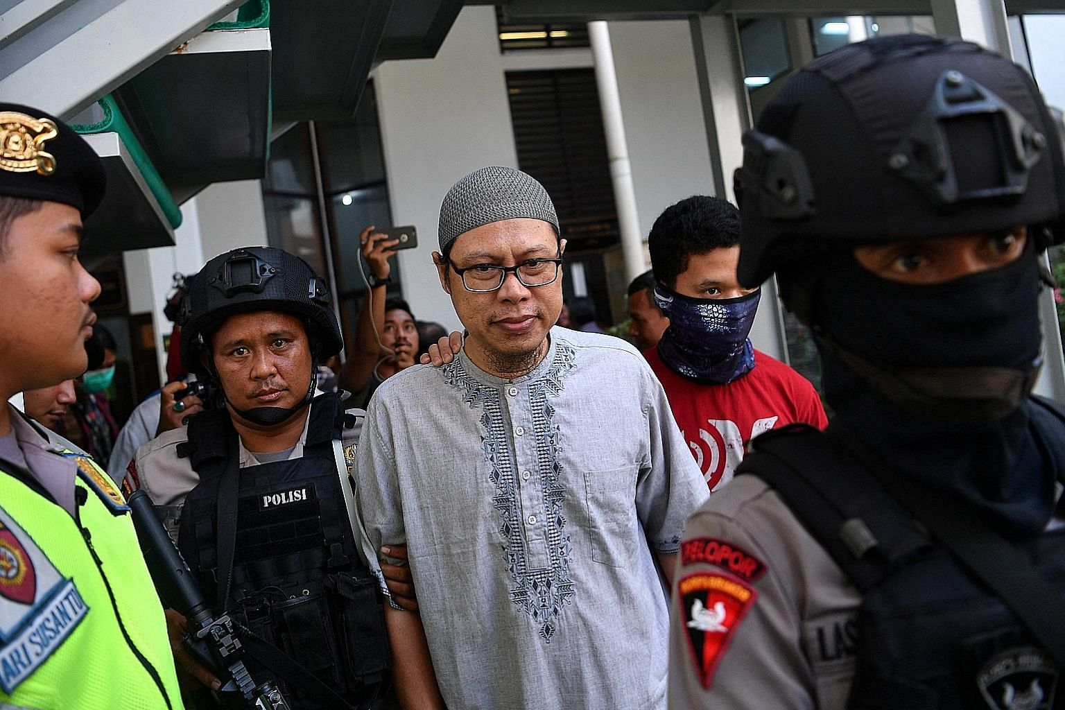 Jemaah Ansharut Daulah leader Zainal Anshori arriving in court in South Jakarta yesterday. His group was charged on July 24 with being an organisation responsible for widespread terrorism.