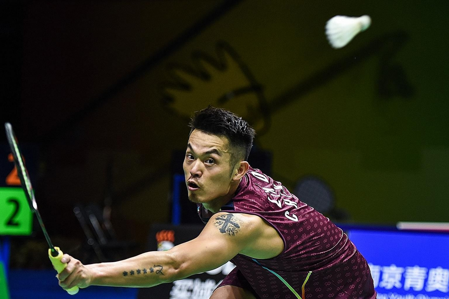 Lin Dan stretching to return against Shi Yuqi during their third-round encounter at the World Championships in Nanjing. The five-time world champion lost 21-15, 21-9 to his younger compatriot in straight games, but has vowed to continue playing at th
