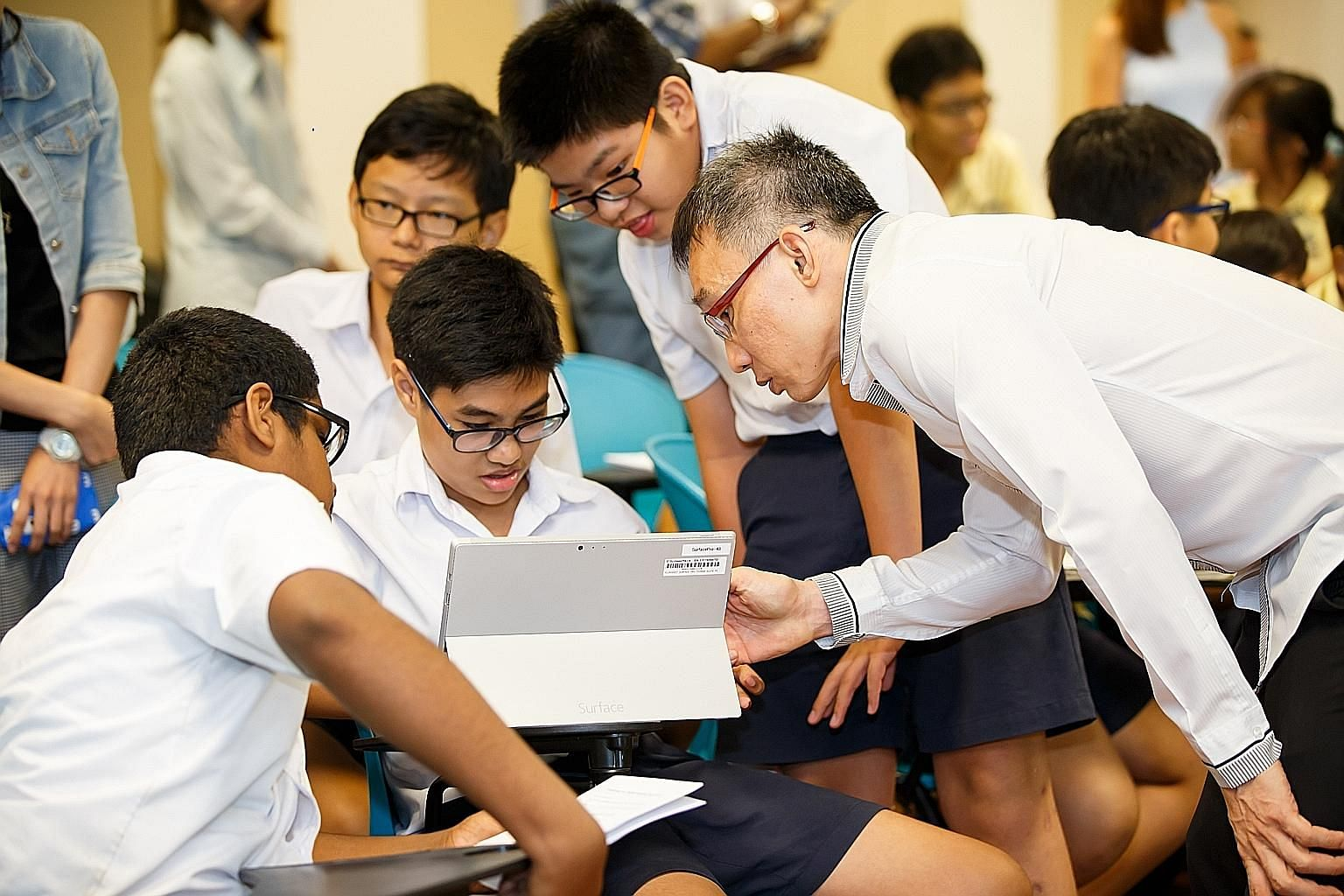 Online safety expert Poh Yeang Cherng (right) conducting a training session for students during the National Cyber Wellness Advocacy Challenge, an annual cyber wellness competition organised by Crescent Girls' School for primary and secondary school