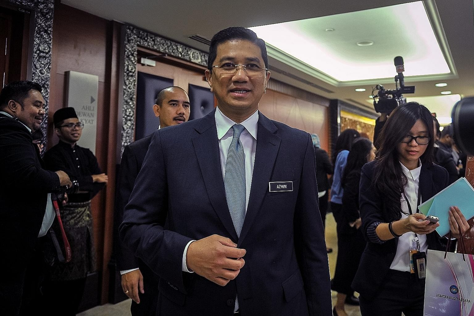 Economic Affairs Minister Mohamed Azmin Ali told reporters outside Malaysia's Parliament yesterday that he was in Singapore to visit Malaysian Home Minister Muhyiddin Yassin but also took the opportunity to meet some senior officials.