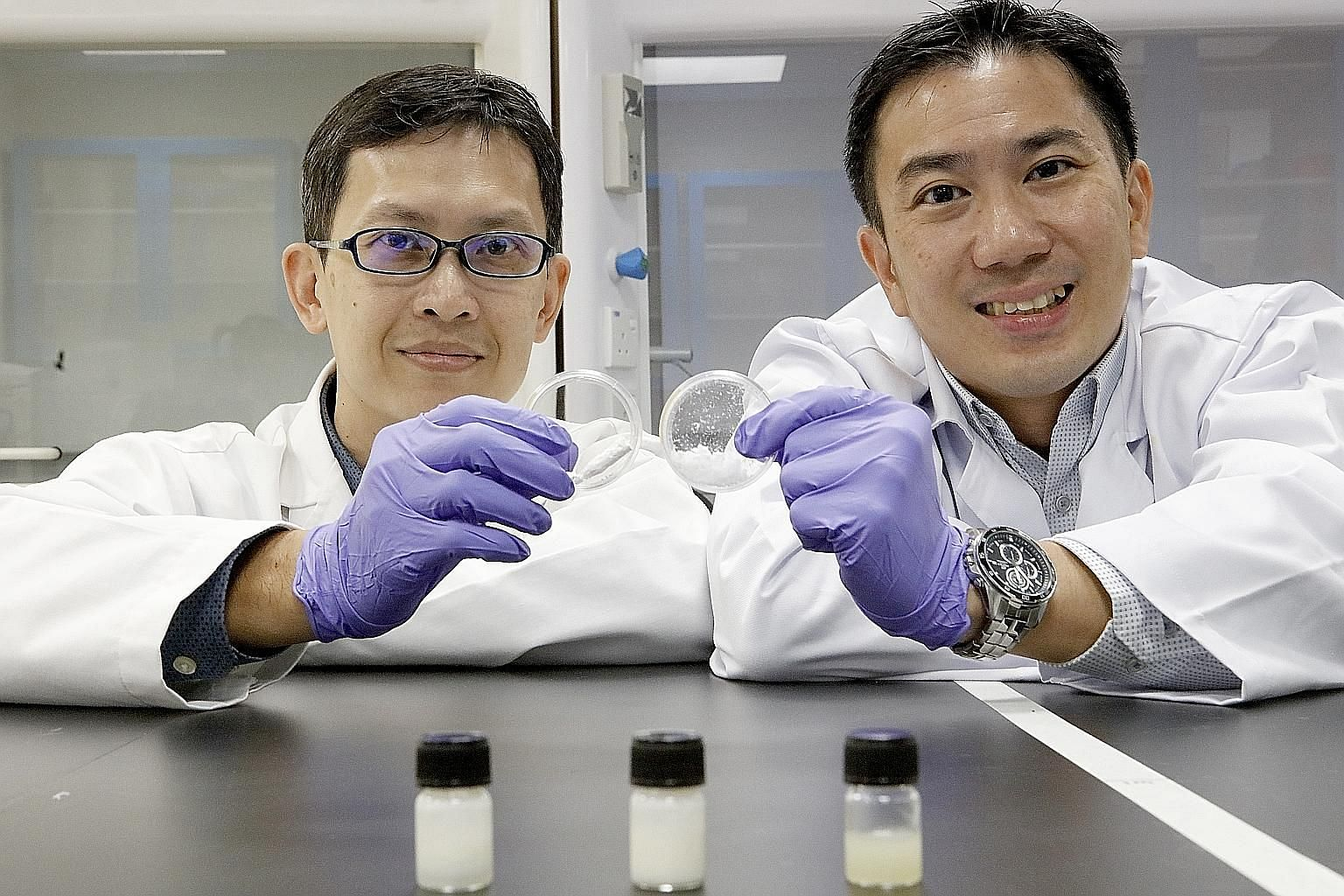 Associate Professor Ng Kee Woei (far left) and Associate Professor Joachim Loo with the nanocellulose fibres which were ground down from wood pulp.