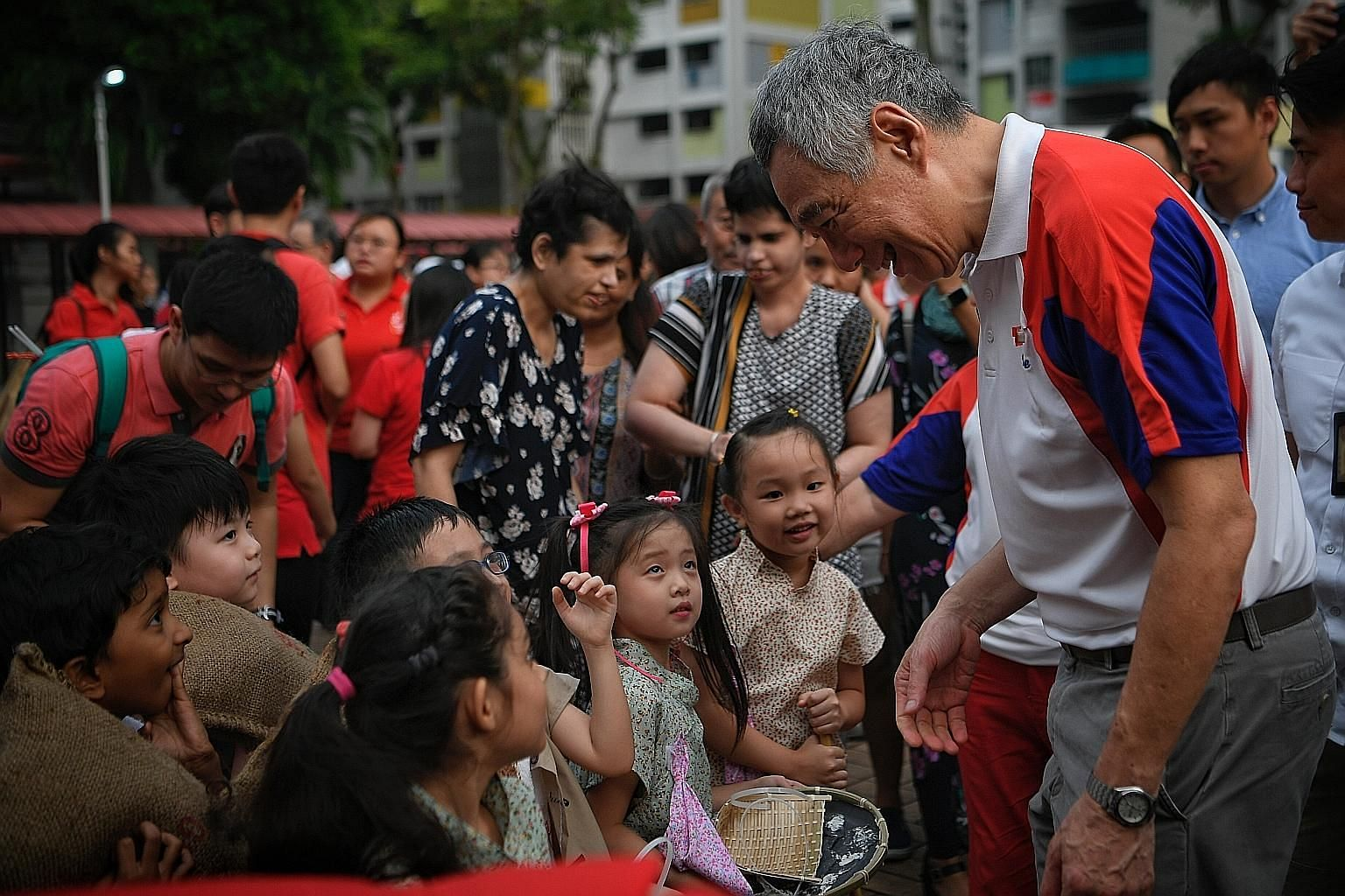 Prime Minister Lee Hsien Loong meeting PCF Sparkletots Preschool children who performed as samsui women during the National Day celebration in Ang Mo Kio Street 31 yesterday.