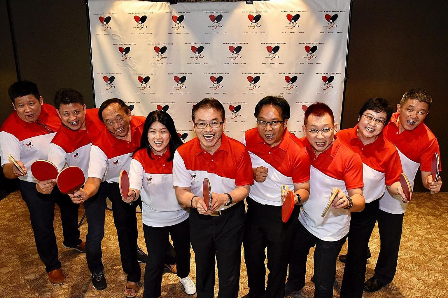 Toh Kian Lam (centre) and his team members running in the STTA election (from left) Bernard Tan, Eric Fong, Terry Tan, Patricia Kim, Ow Chee Chung, Marcus Tan, Wu Xiaowen and Andrew Tan.