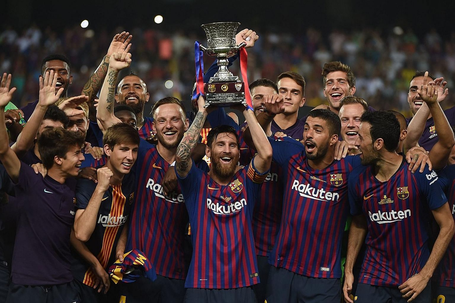 Barcelona captain Lionel Messi lifting the Spanish Super Cup after they came from behind to beat Sevilla 2-1 at the Ibn Batouta Stadium in the Moroccan city of Tangier.