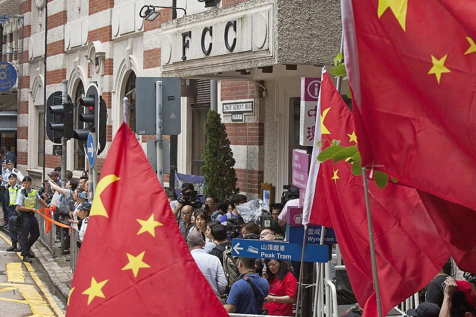 Pro-China supporters gathering outside the Foreign Correspondents' Club (FCC) in Central, Hong Kong, yesterday to protest against a talk by activist Andy Chan to advocate independence. Both Mr Chan and the FCC had faced intense pressure from the auth