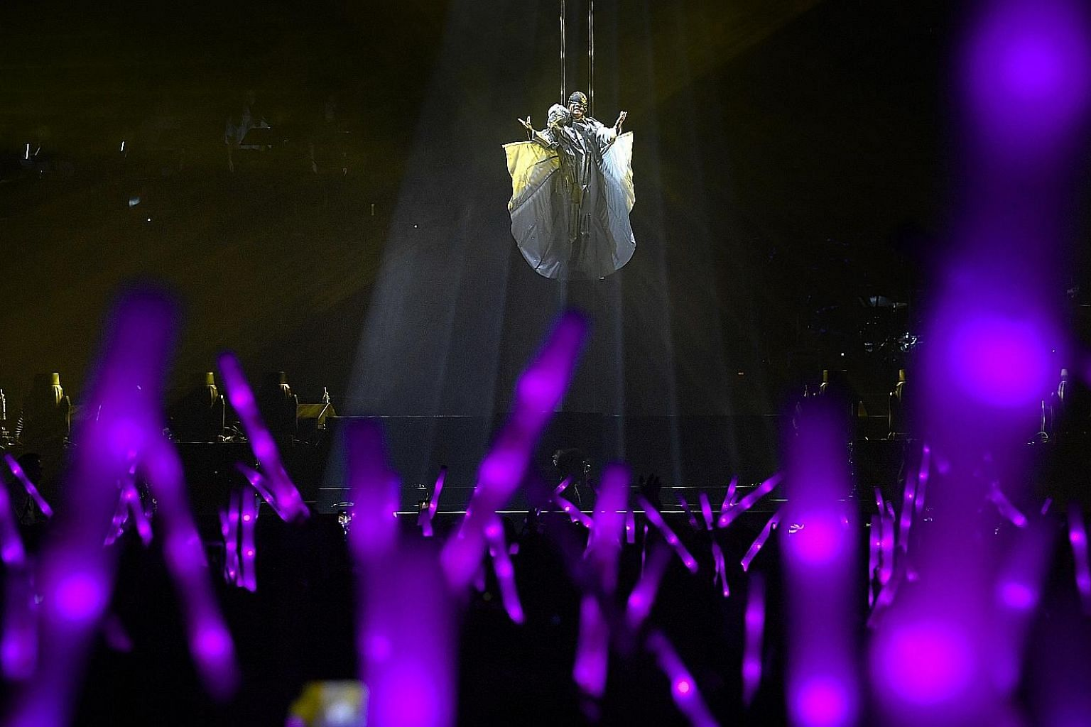 Home-grown Mandopop star JJ Lin made a dramatic entrance for his JJ Lin Sanctuary World Tour at the Singapore Indoor Stadium last night. 	Before an audience of 8,000, he appeared suspended in mid-air, cocooned in white and spinning head over heels sl