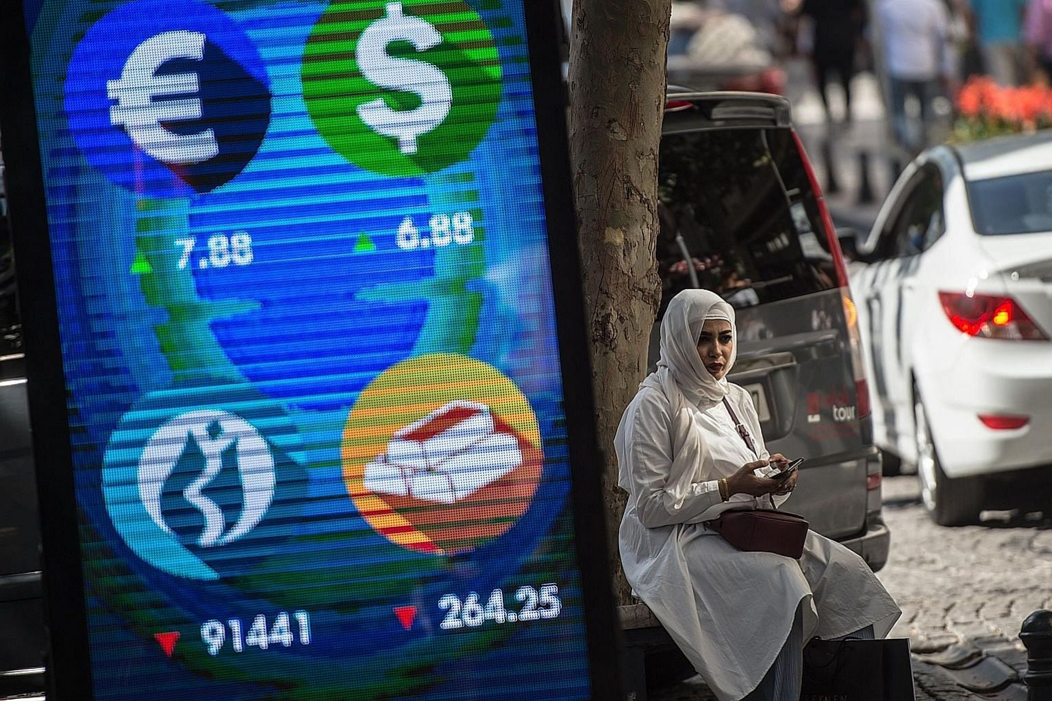 A digital billboard provided updates on various currencies and the Turkish stock exchange in Istanbul on Monday, as the country's lira tumbled against the US dollar, fuelling fears the country's crisis could spill over into the world economy.