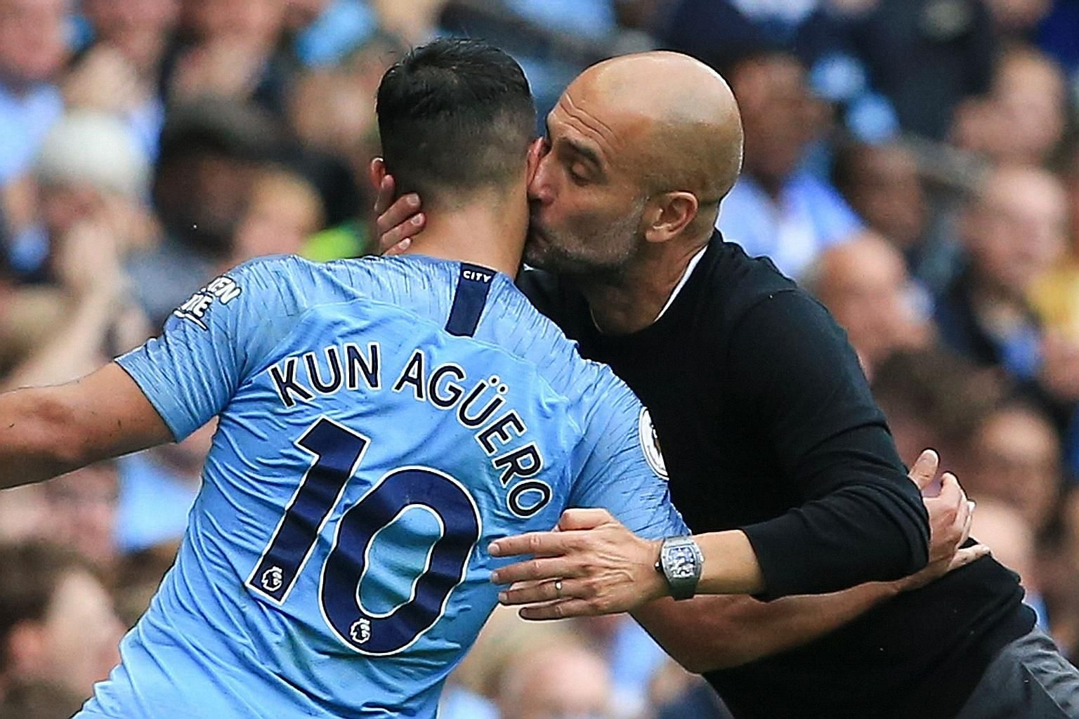 City manager Pep Guardiola kissing Sergio Aguero as the Argentinian striker leaves the pitch after Leroy Sane replaced him.