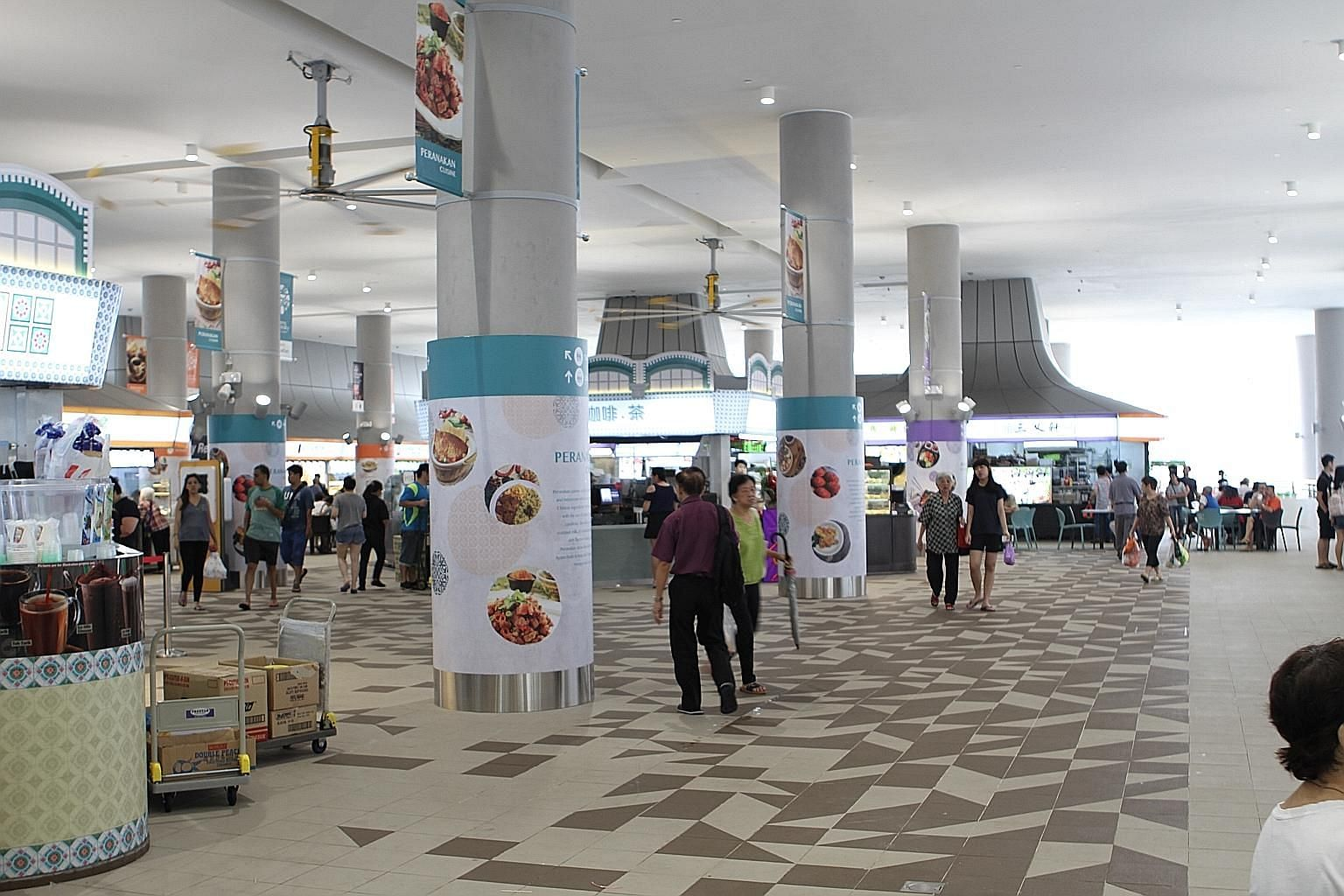 The food centre at Kampung Admiralty, a development that has been held up as an example of what the Government is doing to transform education, healthcare and housing to improve lives. The writer says smart use of data can foster a spirit of together