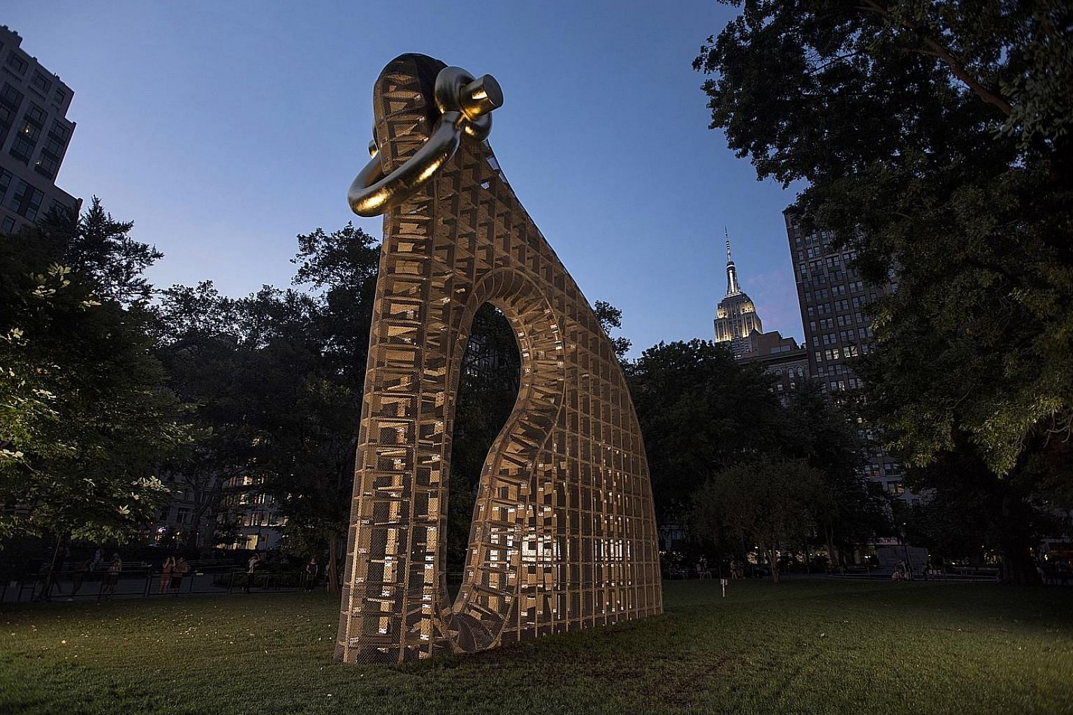 Martin Puryear's sculpture Big Bling, a 12.2m-high construction of plywood and chain-link fencing with a gold-leaf shackle, in Madison Square Park in New York.