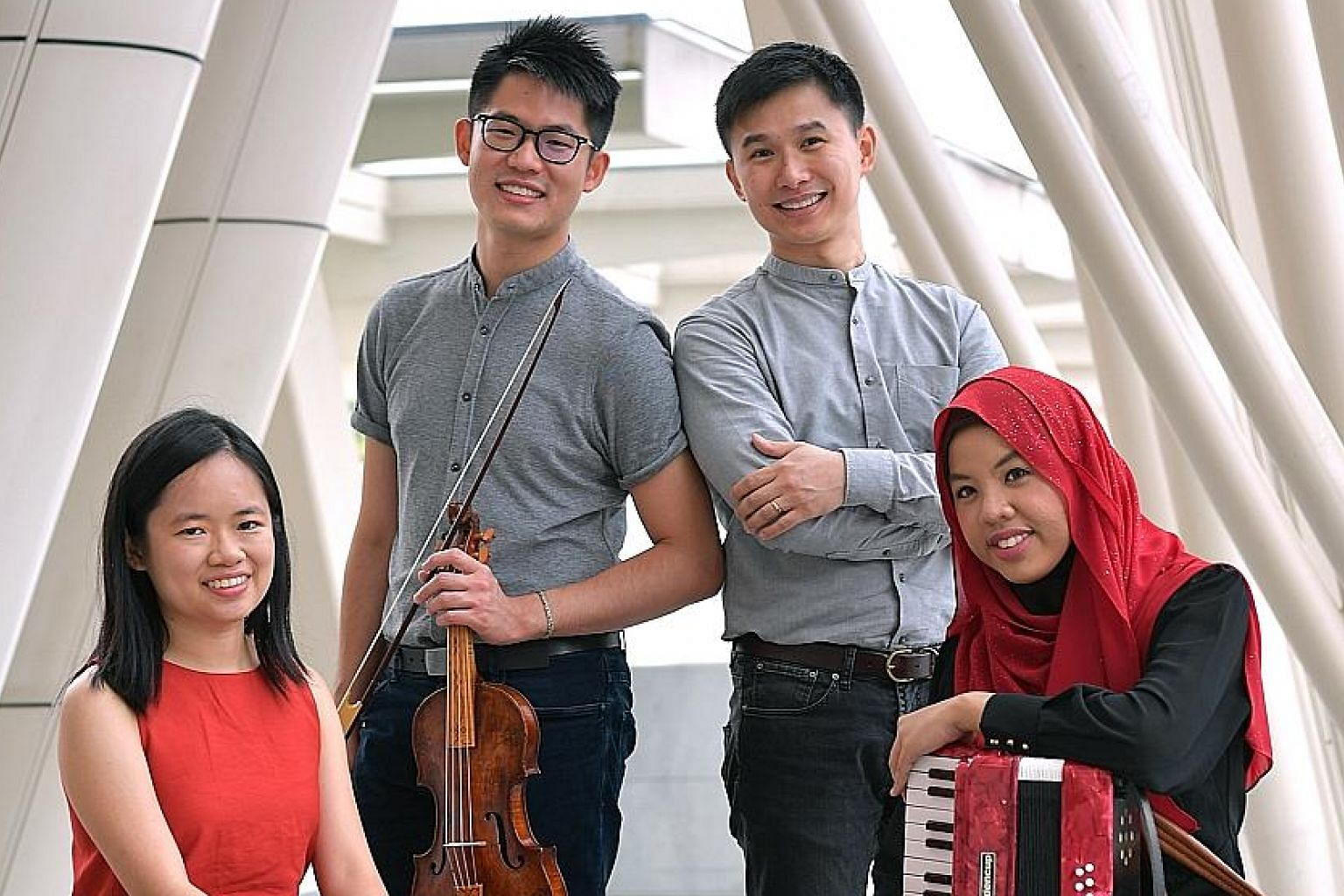 Alumni of the Yong Siew Toh Conservatory, (from left) Abigail Sin, Alan Choo, Chen Zhangyi and Syafiqah 'Adha Sallehin, who will perform at the Voyage: And Beyond music festival.