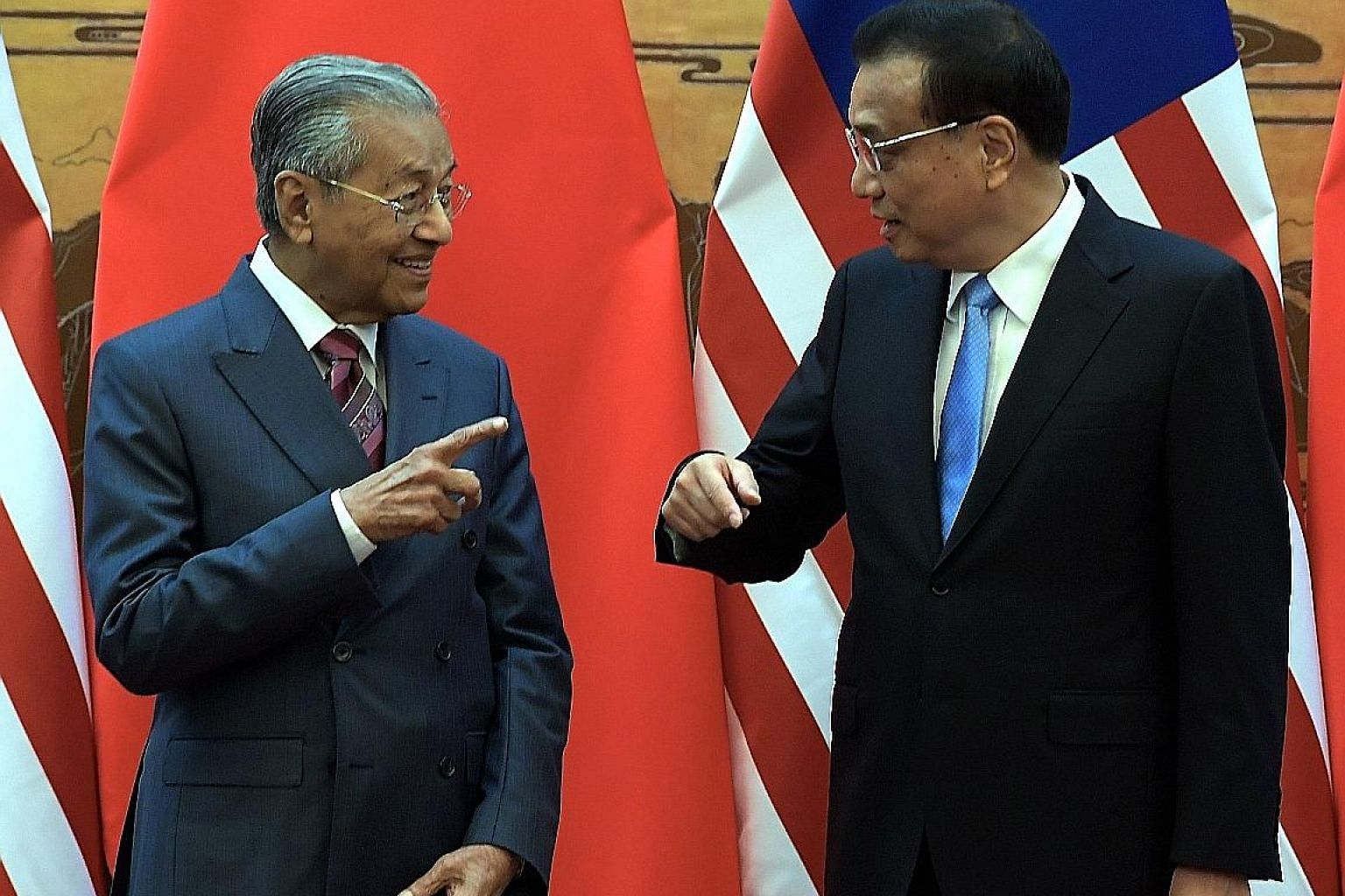 Malaysian Prime Minister Mahathir Mohamad with Chinese Premier Li Keqiang at the Great Hall of the People in Beijing on Monday.