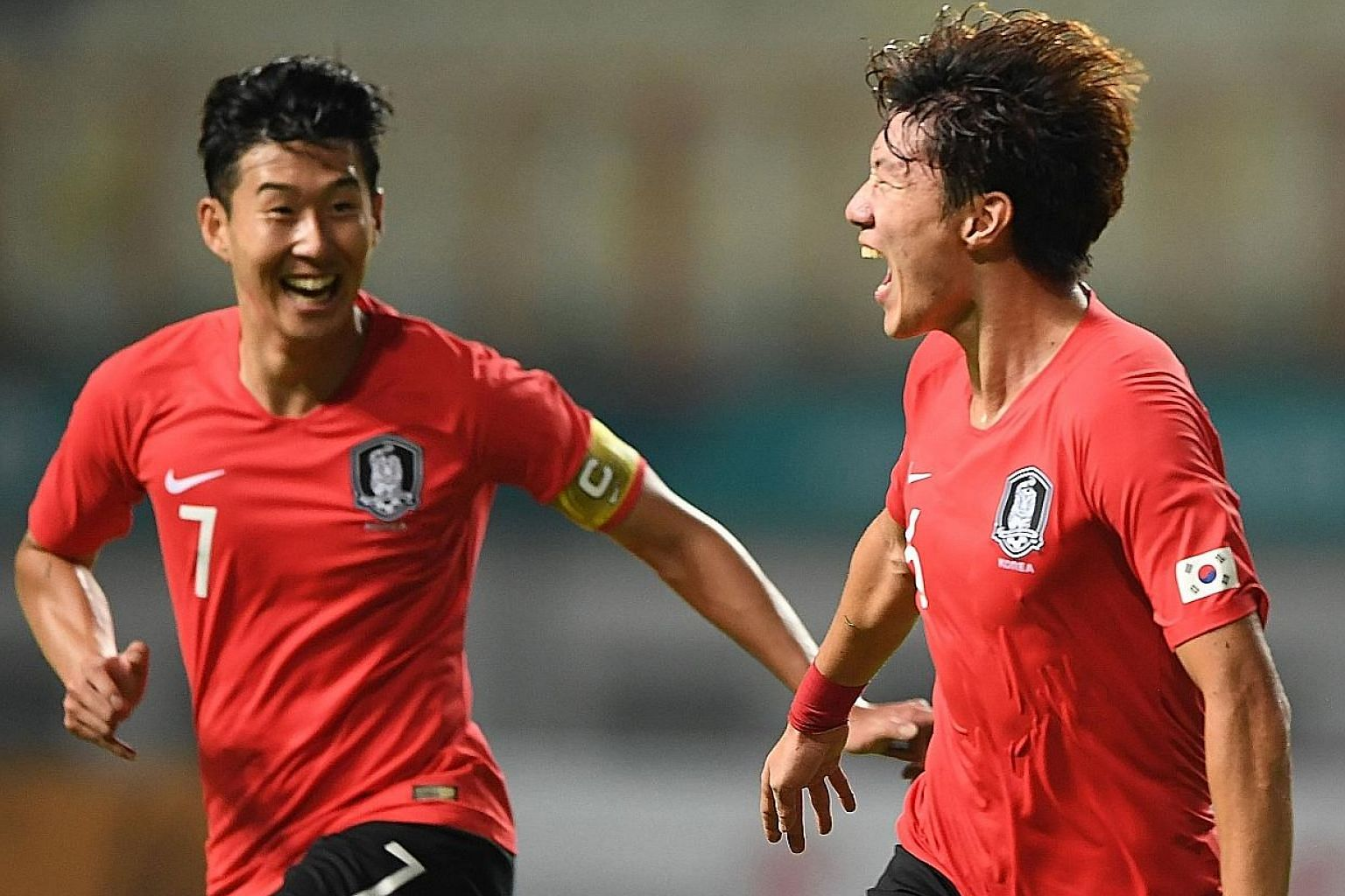 Above: South Korea's Hwang Ui-jo celebrating their first goal against Iran with team captain Son Heung-min during their round-of-16 match in Cikarang yesterday. They next face Uzbekistan in the quarter-finals. Left: Vietnam's Nguyen Cong Phuong (No.