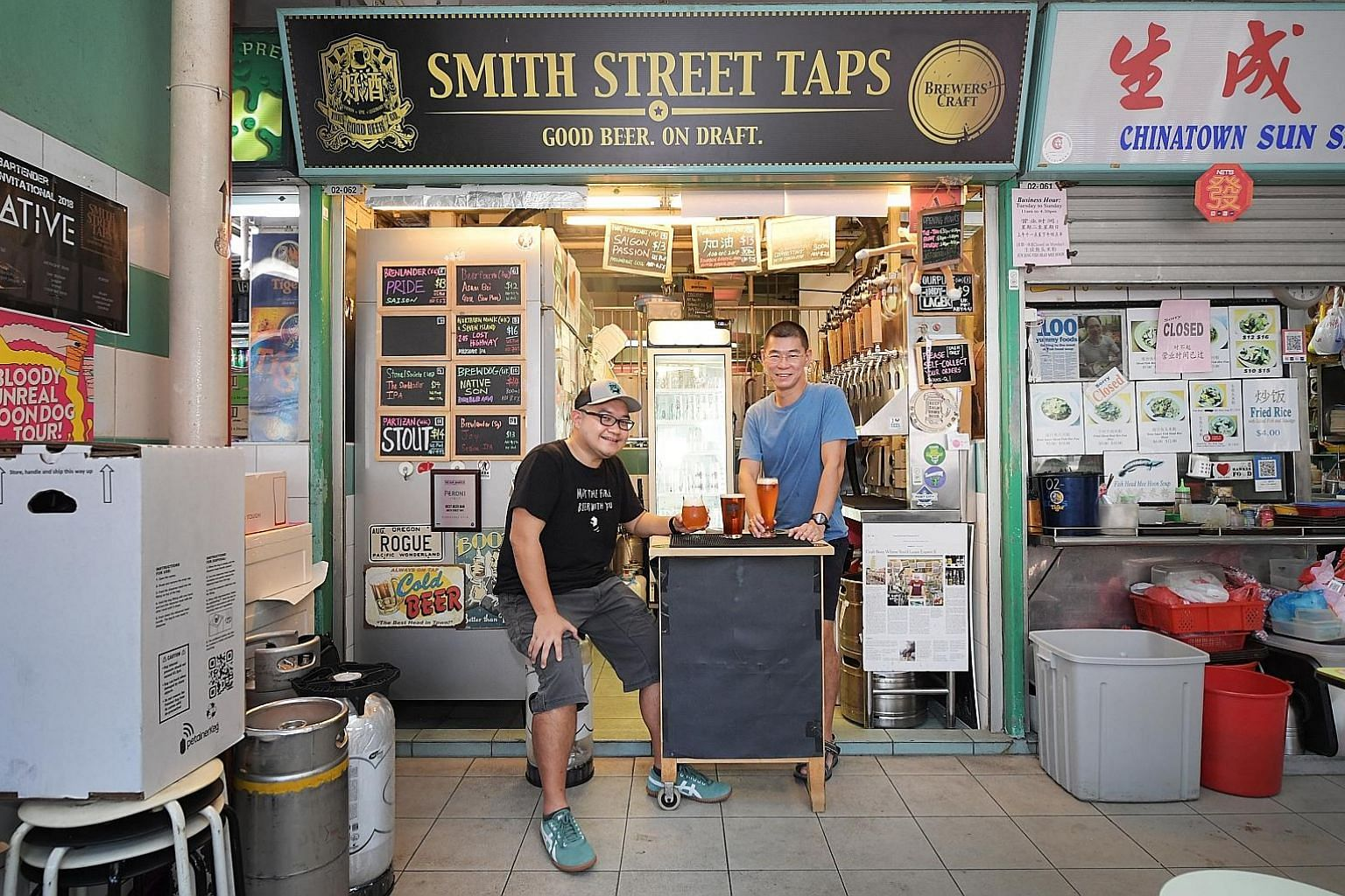 Smith Street Taps co-founders Daniel Goh (above left) and Meng Chao with the three collaboration beers they are presenting at Beerfest Asia. Mr Casey Choo (far left) of That Singapore Beer Project and Mr Daryl Yeap (left) of Daryl's Urban Ales brew t