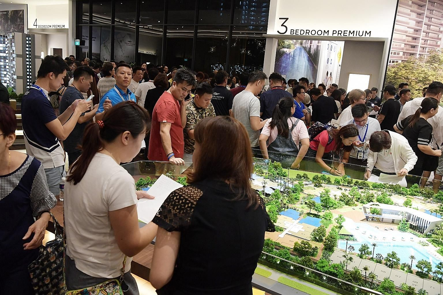 A large crowd of buyers gathered at the Riverfront Residences showflat on July 5, after property cooling measures were announced that day. Some 52 per cent of its 1,472 units have been sold.
