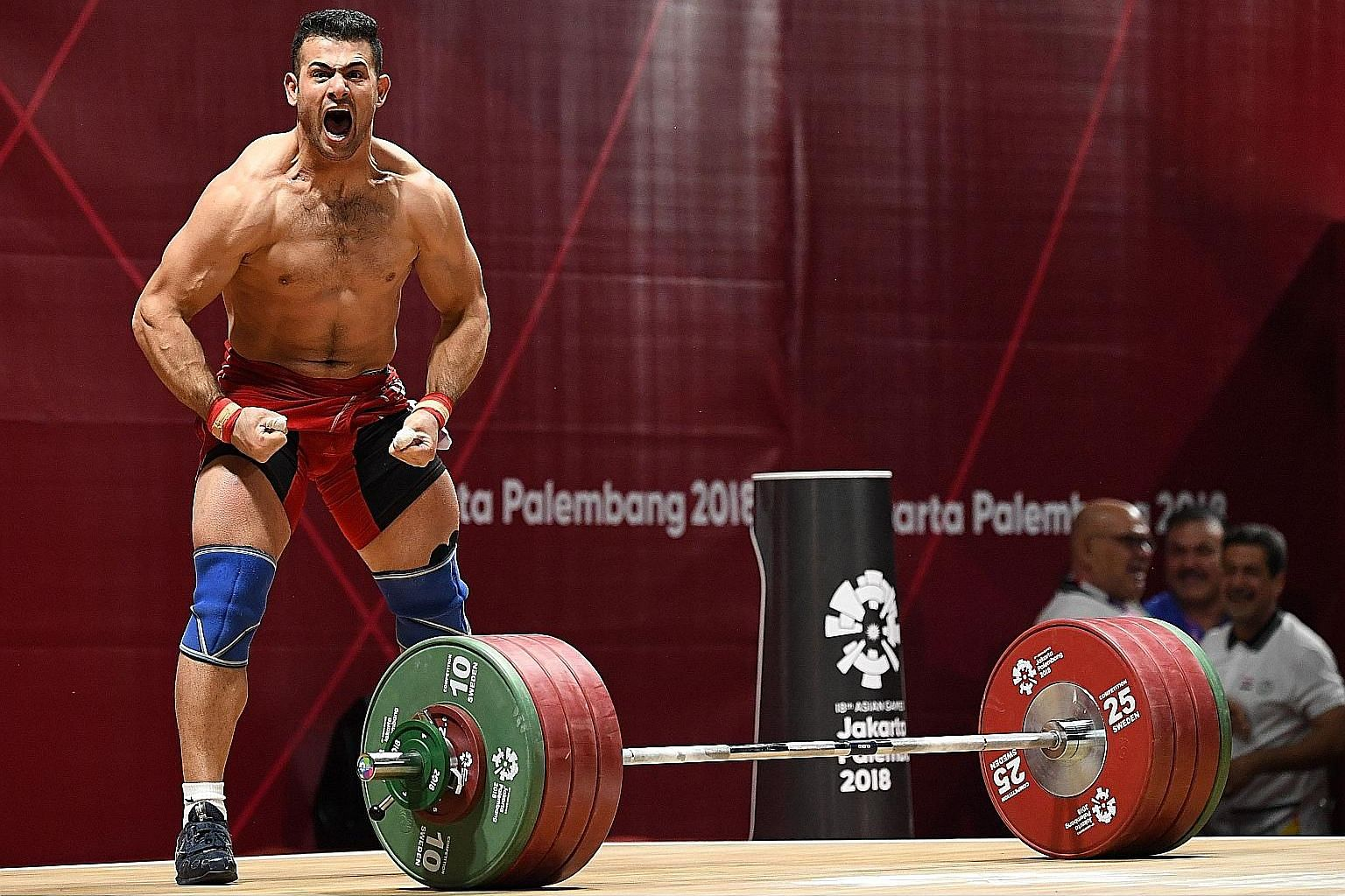 Iraq's Safaa Aljumaili's unbridled and bare-bodied reaction to winning Iraq's first gold of these Games in the 85kg weightlifting event yesterday. He was joined by an equally overjoyed Iraqi official who kissed the platform several times in thanks.