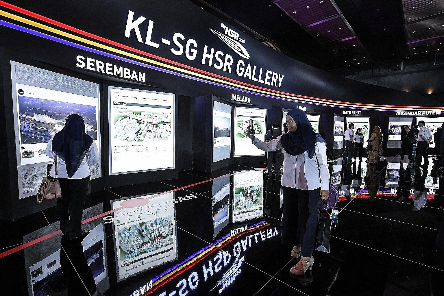 Visitors at an exhibition in Kuala Lumpur last year on the KL-Singapore High-Speed Rail. According to a source, Malaysia and Singapore are studying how long the project should be shelved for, before returning to the discussion table.