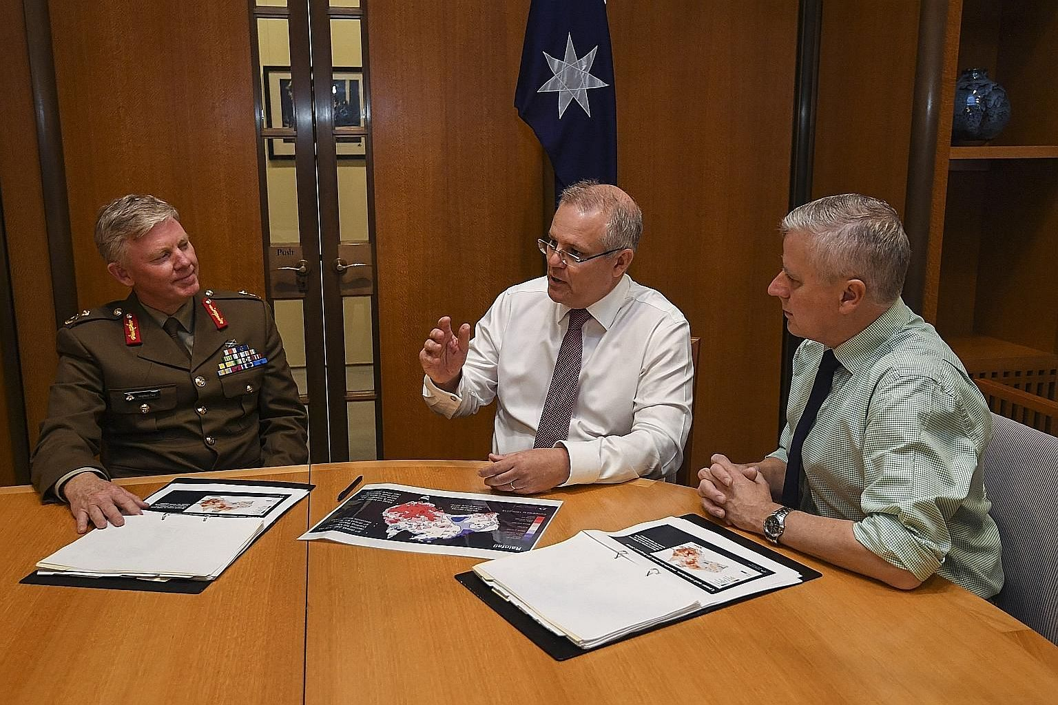 First full day of work for Australia's new Prime Minister Scott Morrison (centre) as he and Deputy Prime Minister Michael McCormack (right) held talks with national drought coordinator Major-General Stephen Day yesterday.